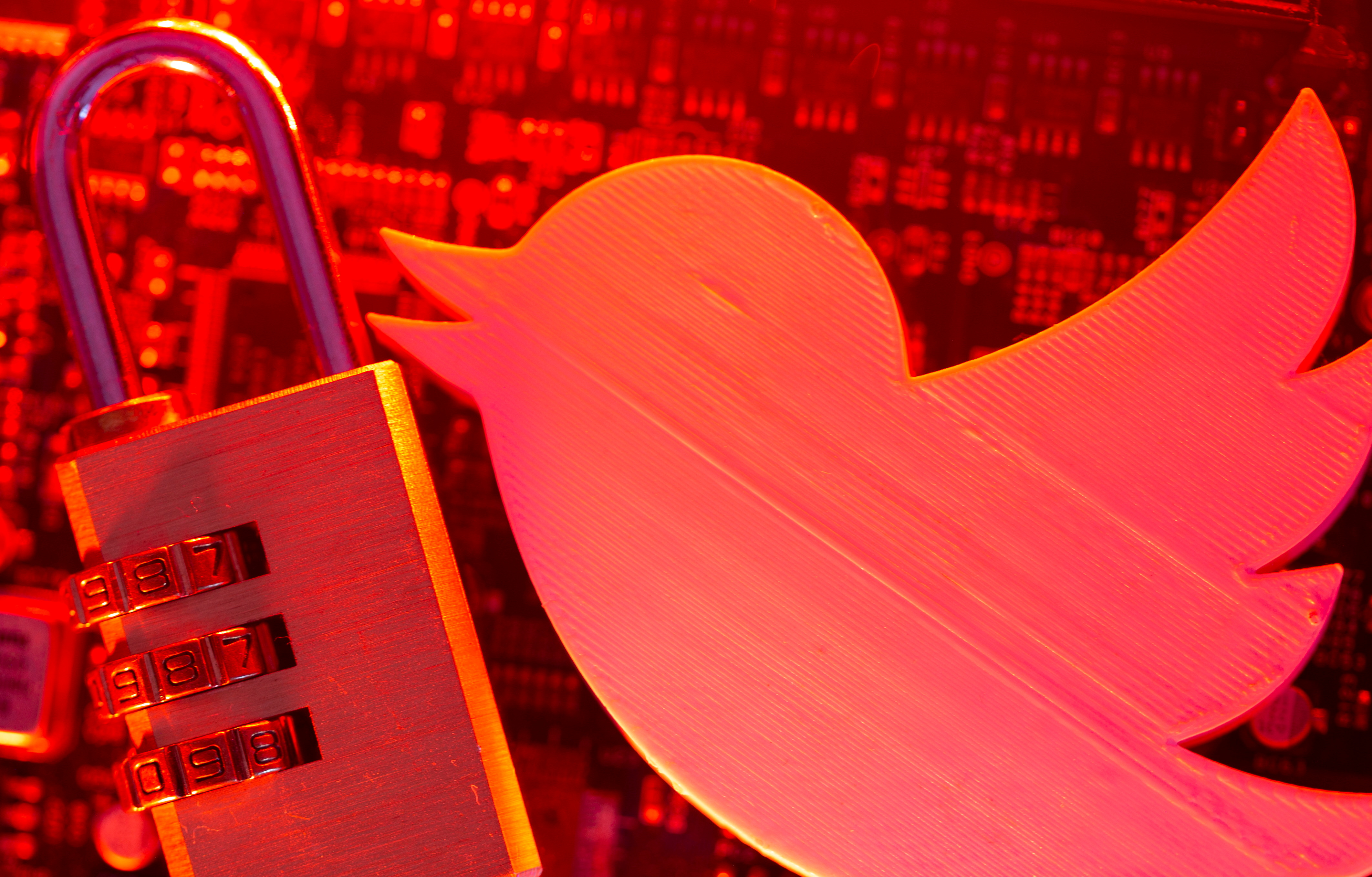 A 3D printed Twitter logo and a padlock are placed on a computer motherboard in this illustration picture taken May 4, 2021. REUTERS/Dado Ruvic/Illustration
