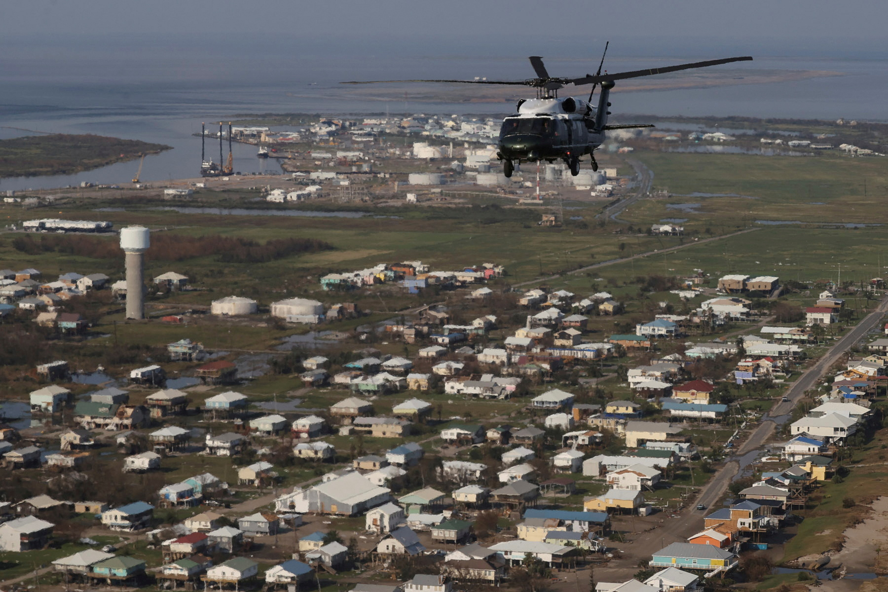 U.S. President Joe Biden, aboard the Marine One helicopter, inspects the damage from Hurricane Ida on an aerial tour of communities in Laffite, Grand Isle, Port Fourchon and Lafourche Parish, Louisiana, U.S. September 3, 2021. REUTERS/Jonathan Ernst/Pool/File Photo