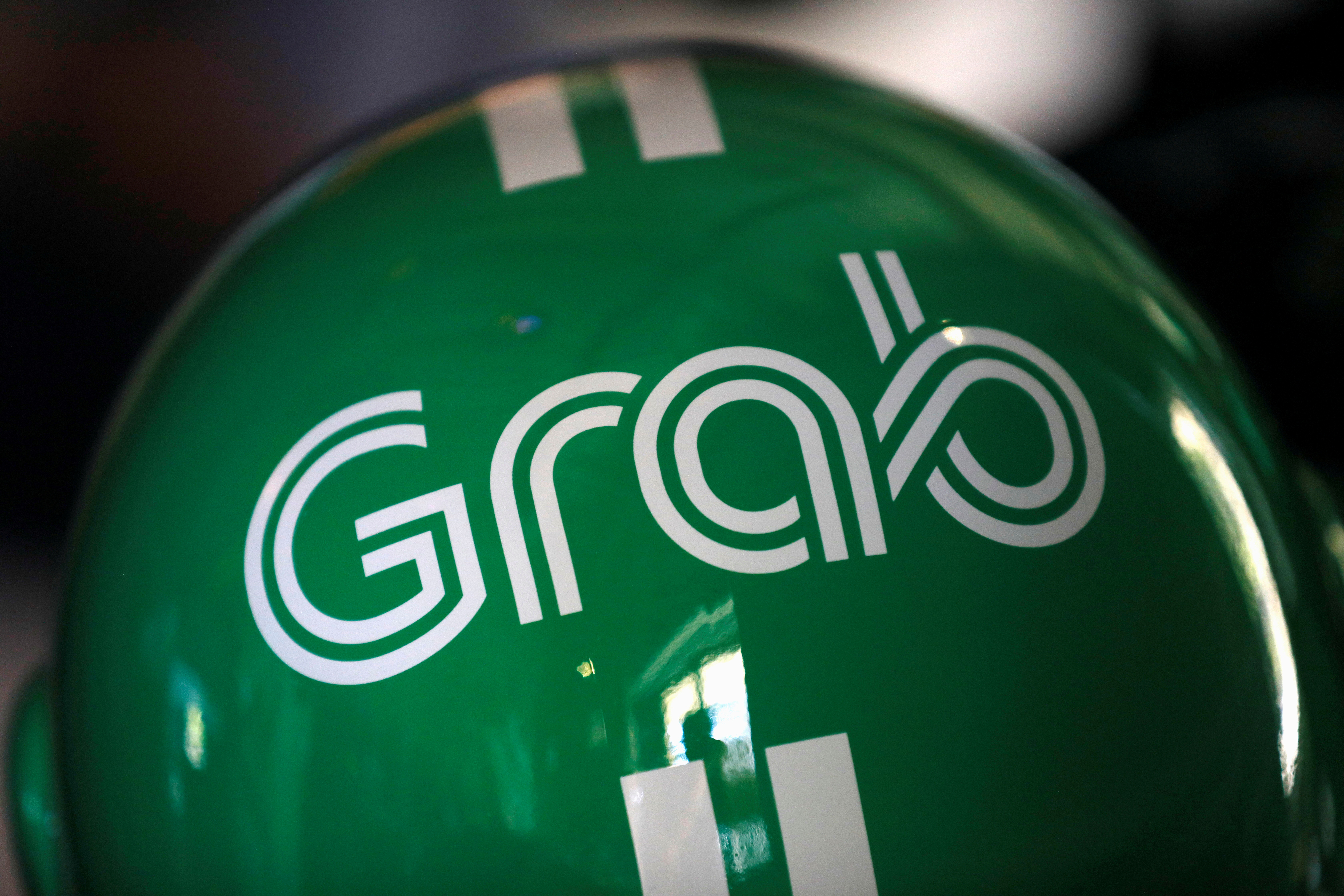 A Grab motorbike helmet is displayed during Grab's fifth anniversary news conference in Singapore June 6, 2017. REUTERS/Edgar Su/File Photo