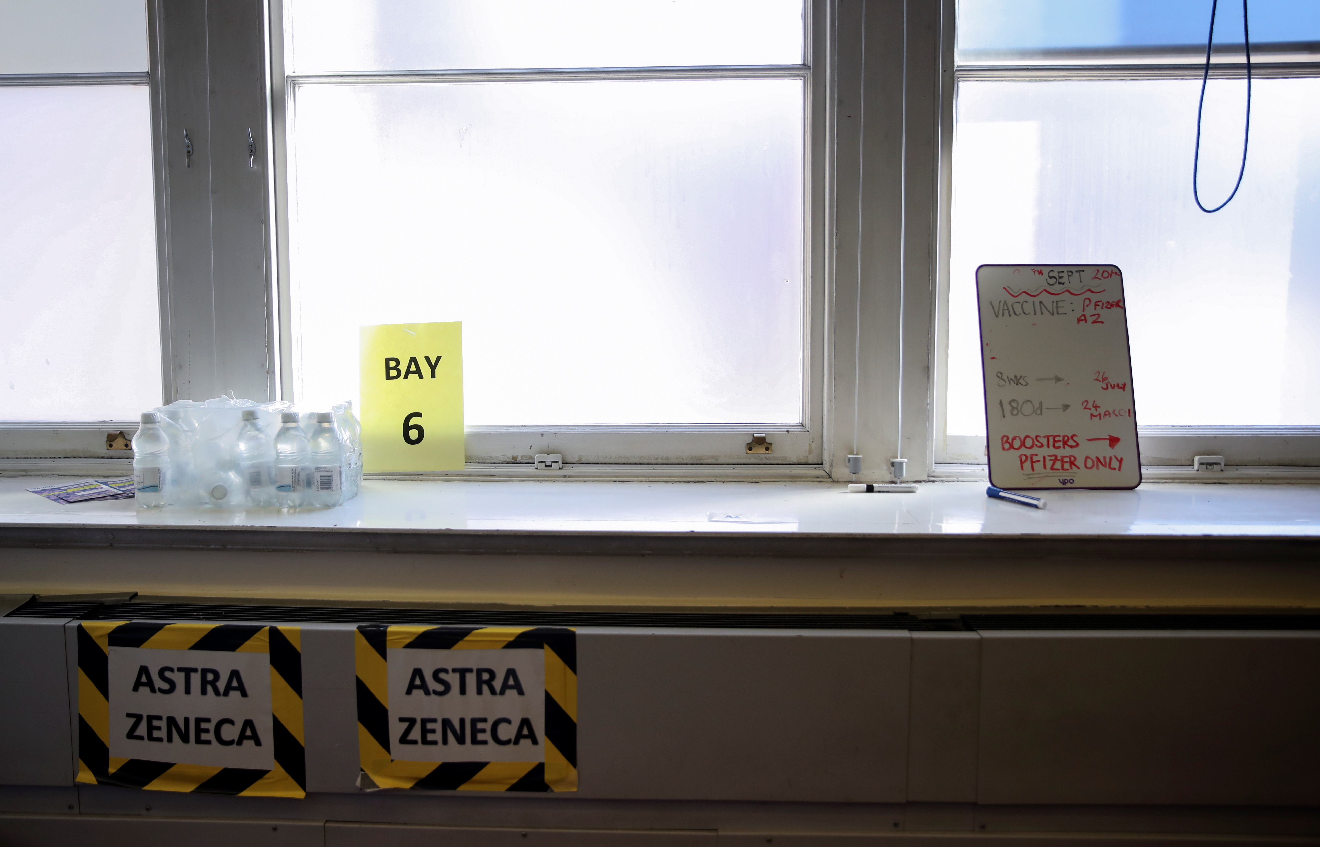 Signs are pictured as healthcare staff receive the COVID-19 booster vaccine, amid the coronavirus disease (COVID-19) pandemic, at Midland House in Derby, Britain, September 20, 2021. REUTERS/Carl Recine