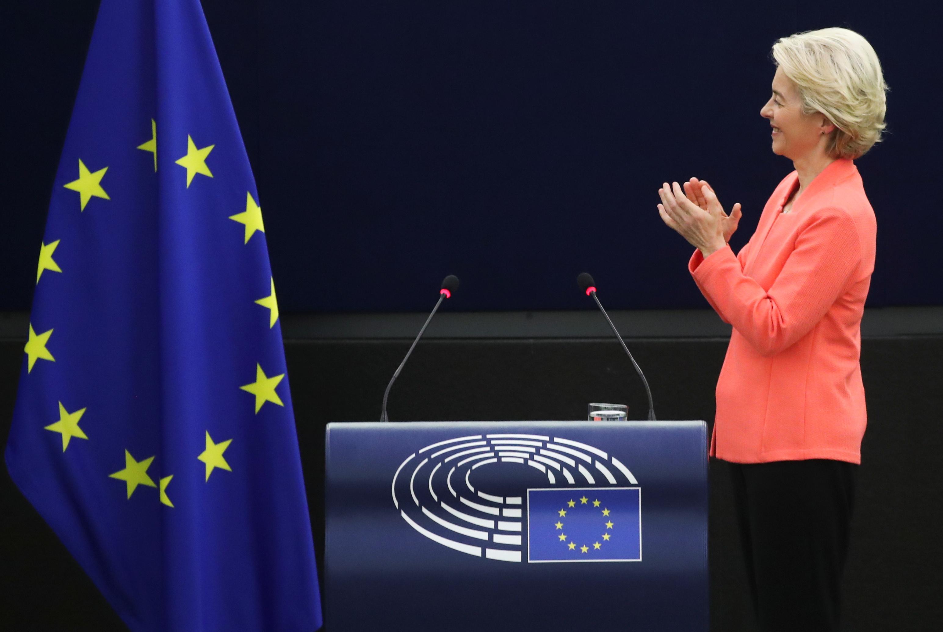European Commission President Ursula von der Leyen applauds Tokyo 2020 Paralympic gold medallist Beatrice Vio as von der Leyen delivers a speech during a debate on