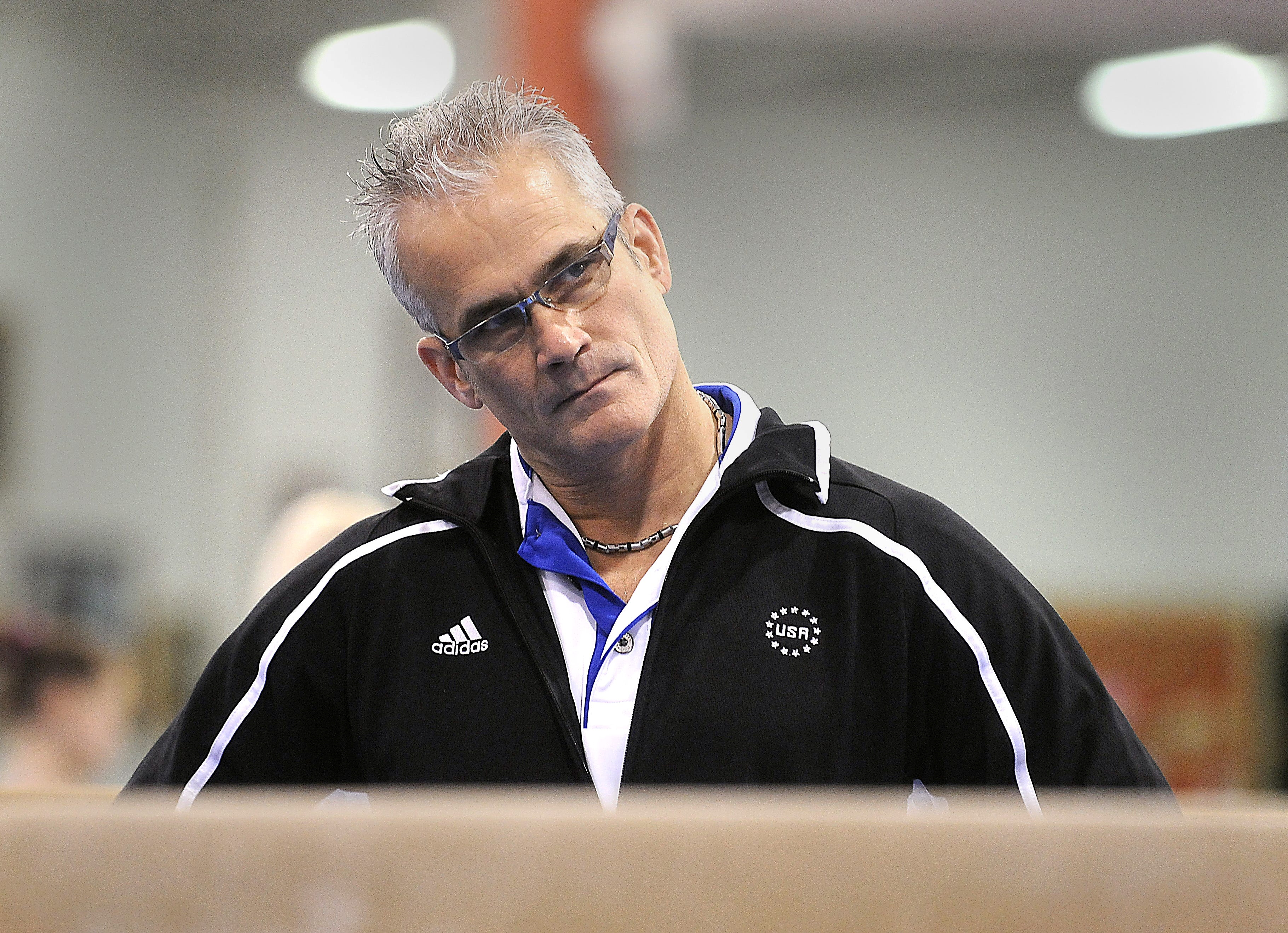 Gymnastics coach John Geddert watches his students during a practice in Lansing, Michigan, U.S. December 14, 2011. Greg DeRuiter/Lansing State Journal/USA Today Network via REUTERS.