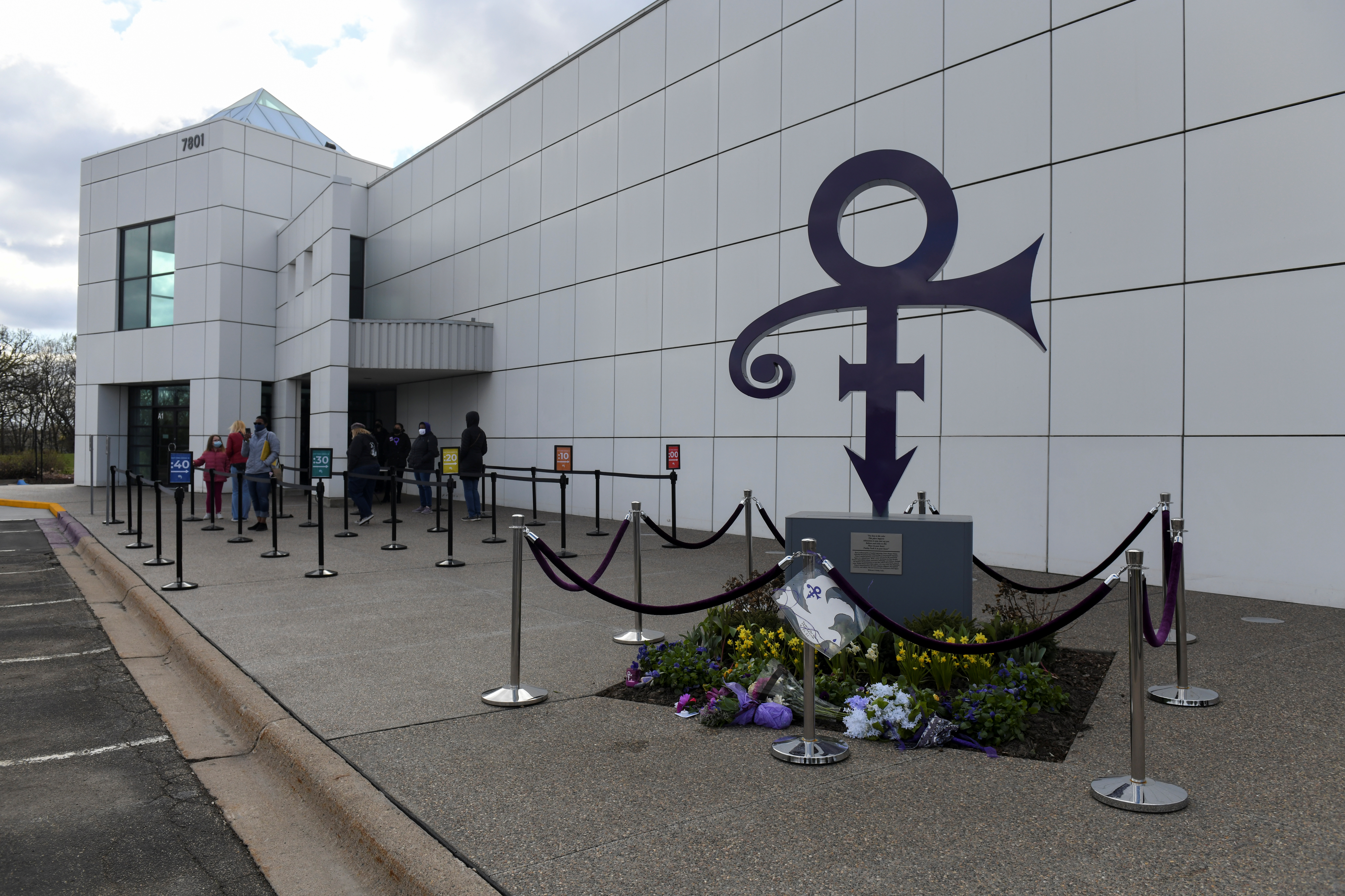 Visitors wait in line outside Paisley Park on the fifth anniversary of Prince's death in Chanhassen, Minnesota, U.S., April 21, 2021. REUTERS/Nicholas Pfosi