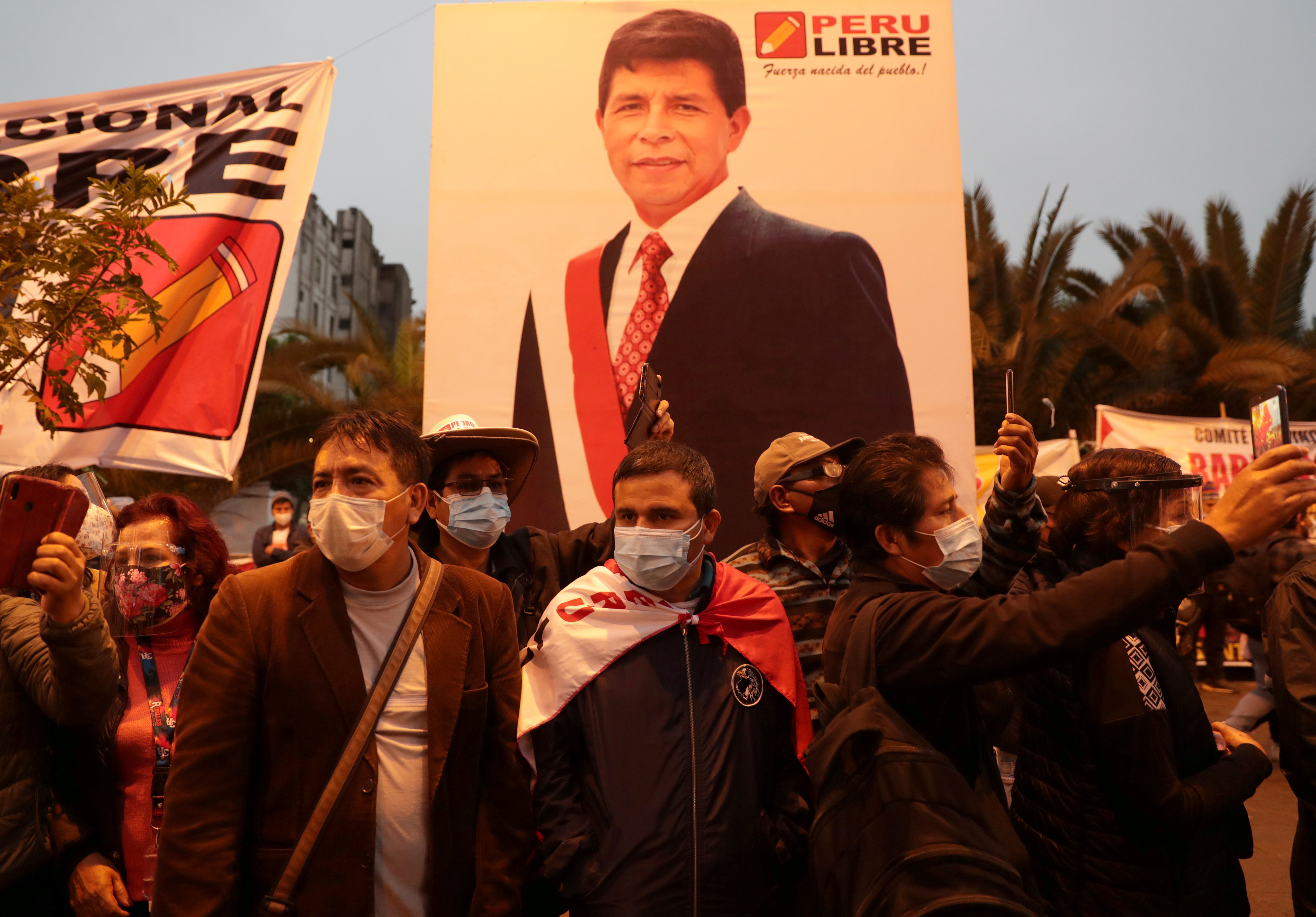 Supporters of Peru's presidential candidate Pedro Castillo gather in Lima, Peru June 19, 2021. REUTERS/Sebastian Castaneda