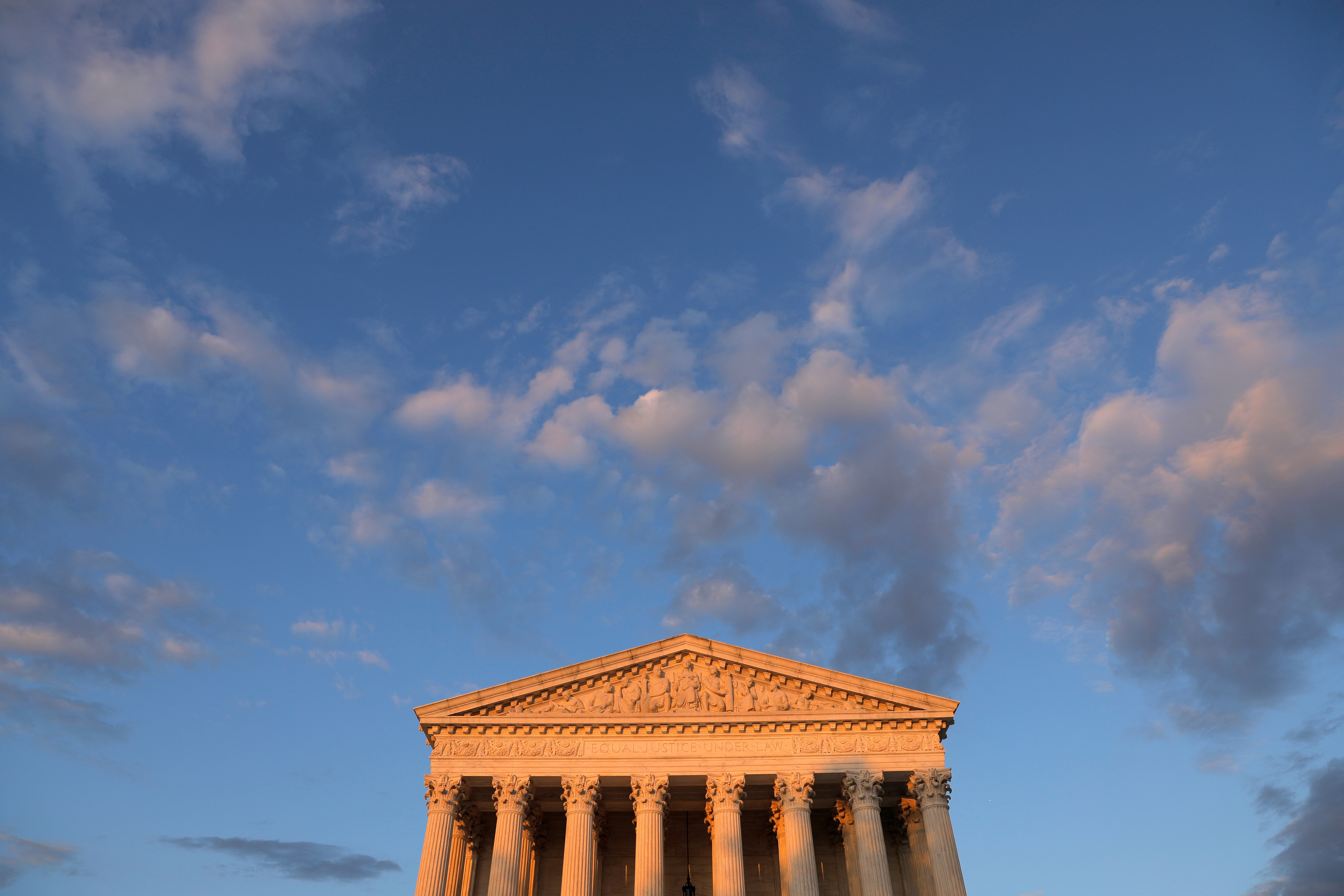 Light from the sunset shines on the United States Supreme Court Building in Washington, D.C., U.S., REUTERS/Andrew Kelly
