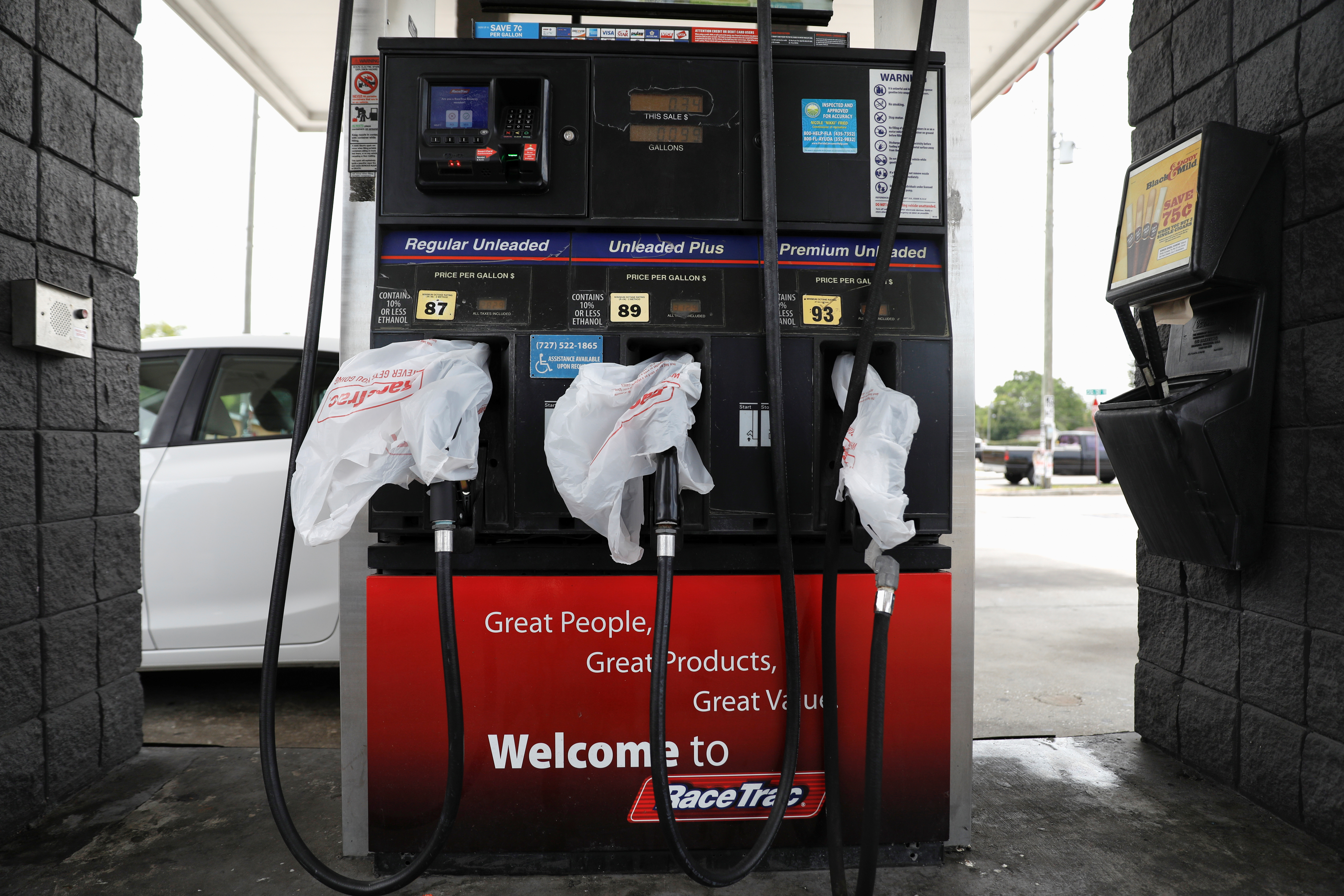 Gas pumps are covered with plastic bags at the Race Trac gas station, after a cyberattack crippled the biggest fuel pipeline in the country, run by Colonial Pipeline, in St. Petersburg, Florida, U.S., May 12, 2021. REUTERS/Octavio Jones