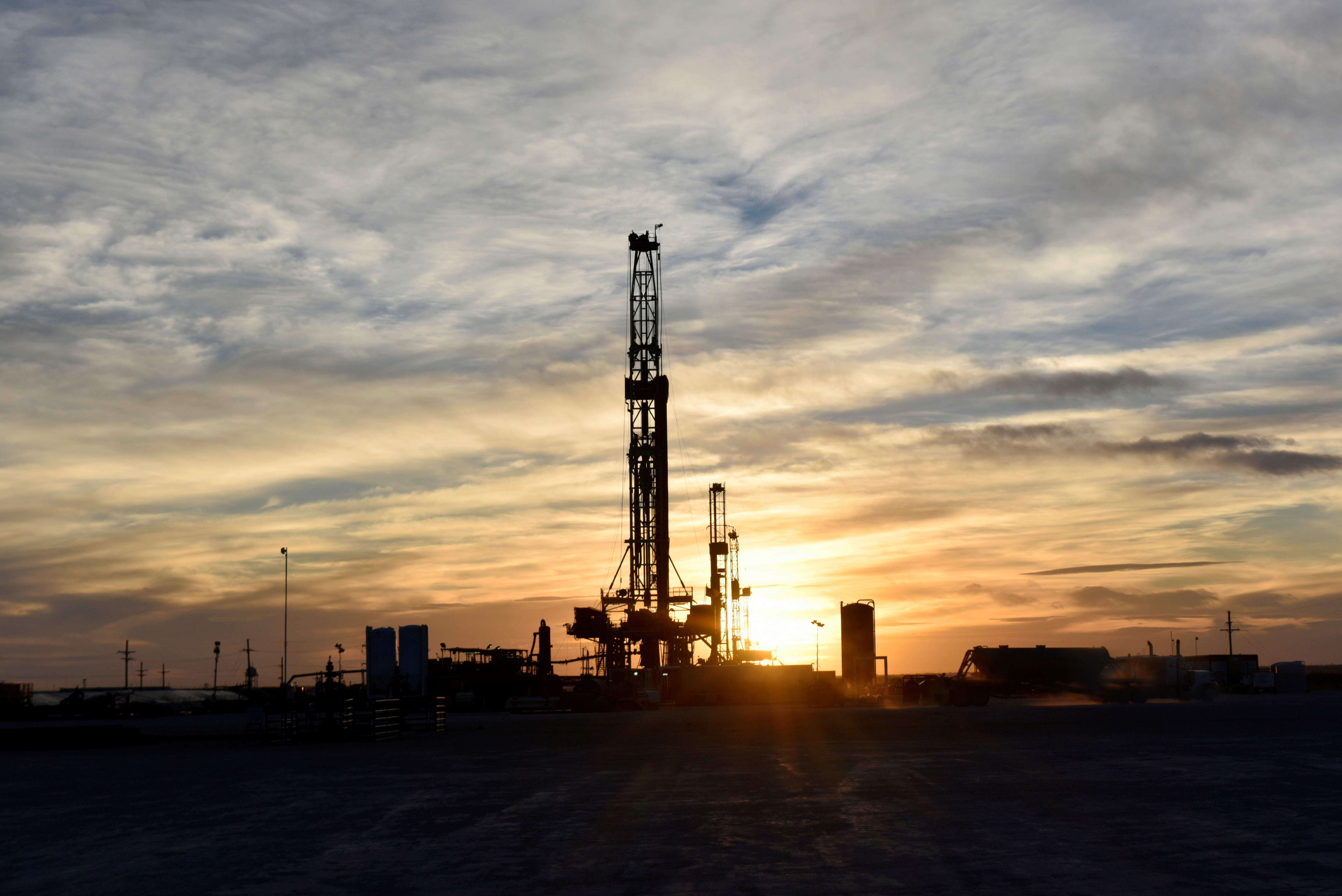 Drilling rigs operate at sunset in Midland, Texas, U.S., February 13, 2019. REUTERS/Nick Oxford