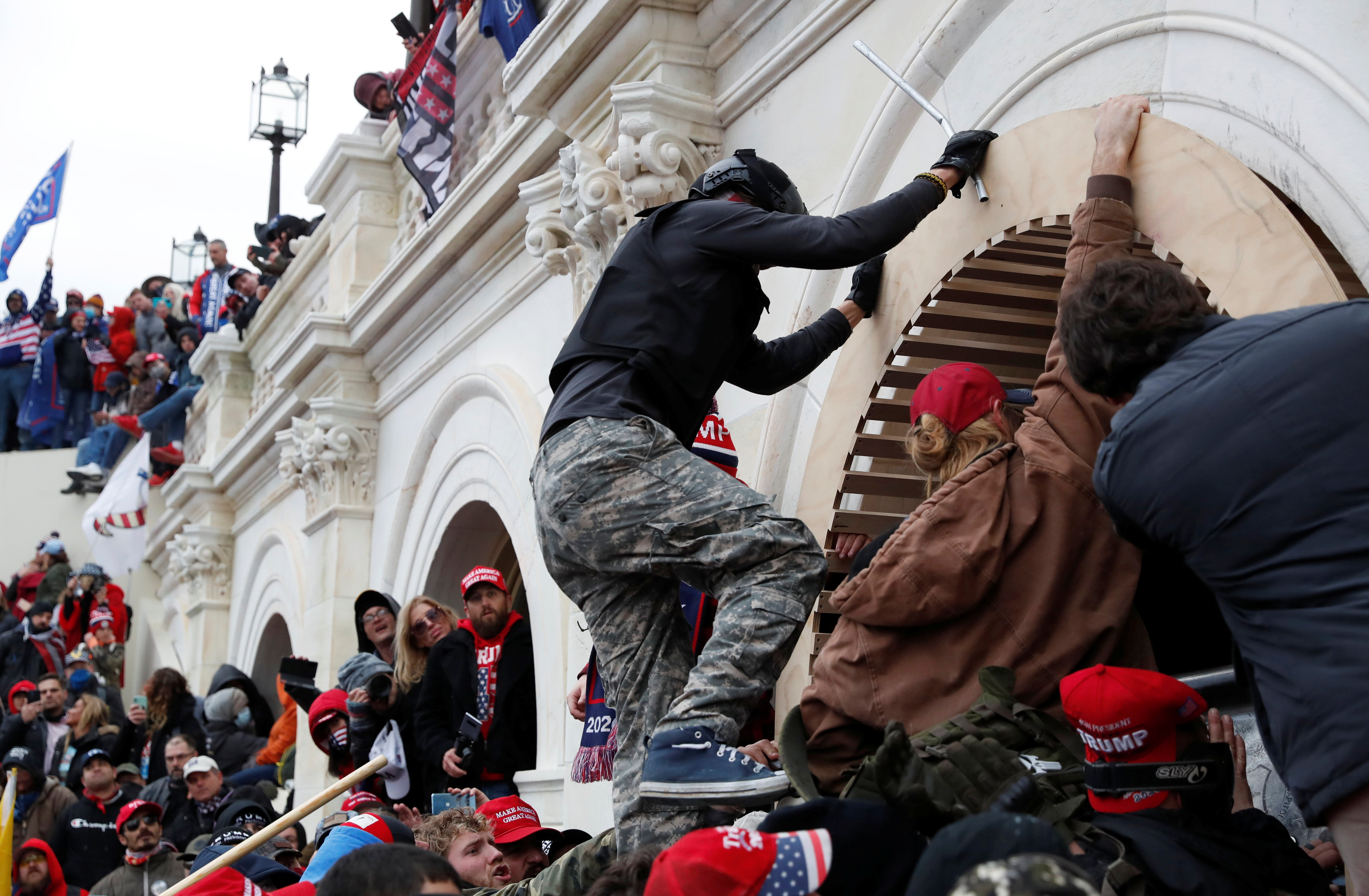Pro-Trump protesters scale a wall as they storm the U.S. Capitol Building, during clashes with Capitol police at a rally to contest the certification of the 2020 U.S. presidential election results by the U.S. Congress, in Washington, U.S, January 6, 2021. REUTERS/Shannon Stapleton
