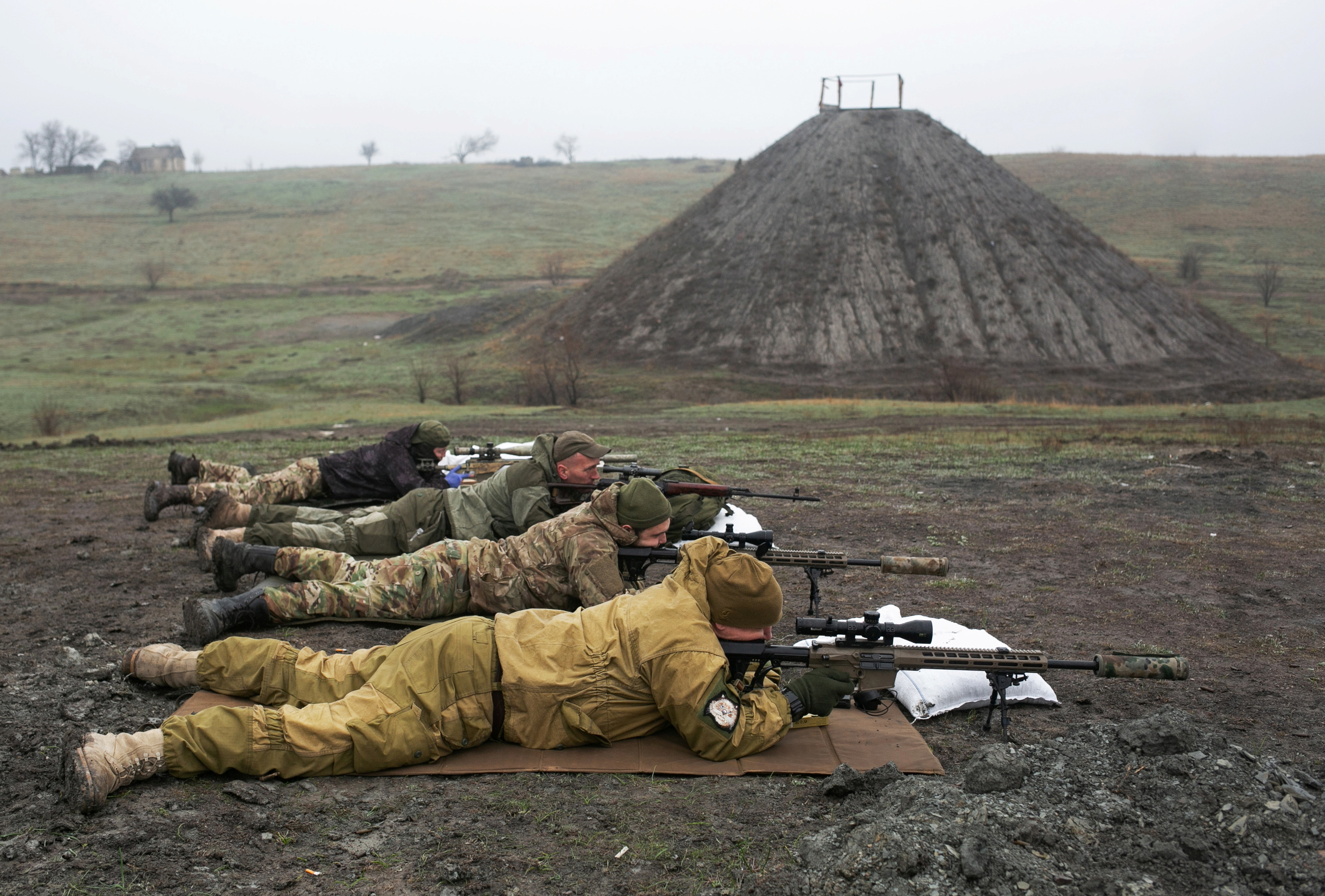 Snipers of the Ukrainian armed forces aim their rifles during training at a firing range near the town of Marinka inDonetsk region, Ukraine April 13, 2021. REUTERS/Anastasia Vlasova