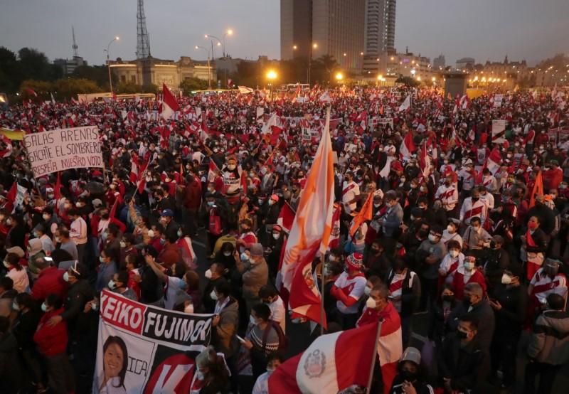 Supporters of Peru's presidential candidate Keiko Fujimori gather during a demonstration in Lima Peru June 12, 2021. REUTERS/Sebastian Castaneda