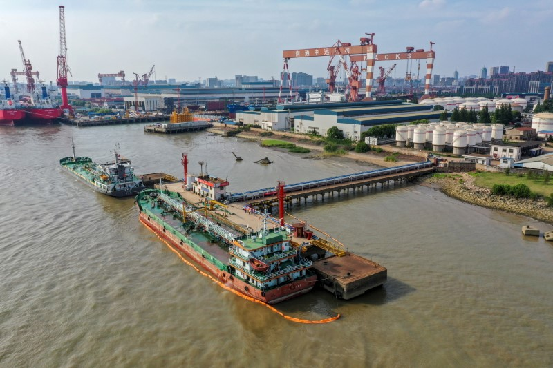 Oil tankers are seen at a terminal of Sinopec Yaogang oil depot in Nantong, Jiangsu province, China June 11, 2019. Picture taken June 11, 2019. REUTERS/Stringer/File Photo