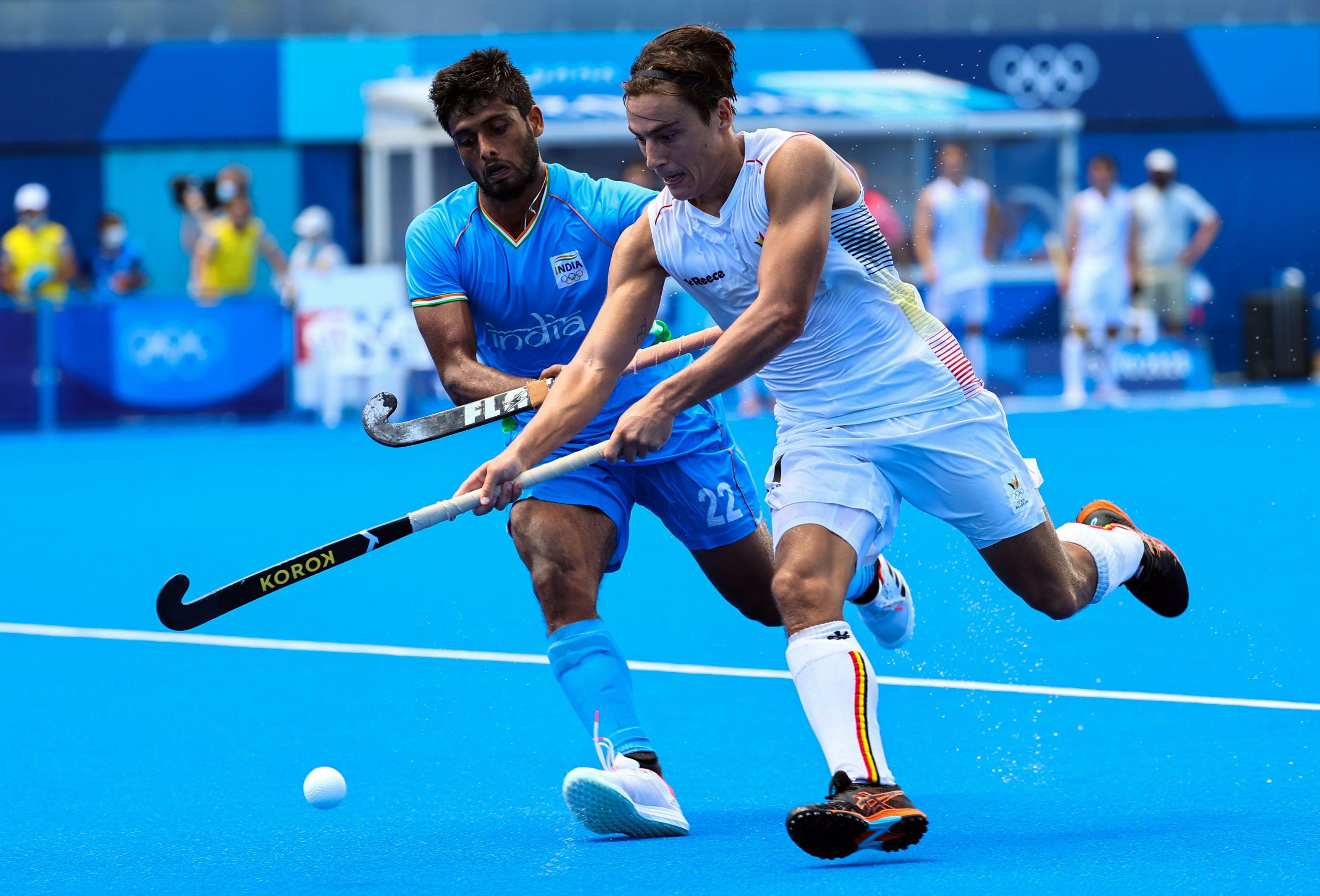 Tokyo 2020 Olympics - Hockey - Men - Semifinal - India v Belgium - Oi Hockey Stadium, Tokyo, Japan - August 3, 2021. Thomas Briels of Belgium in action against Varun Kumar of India. REUTERS/Bernadett Szabo