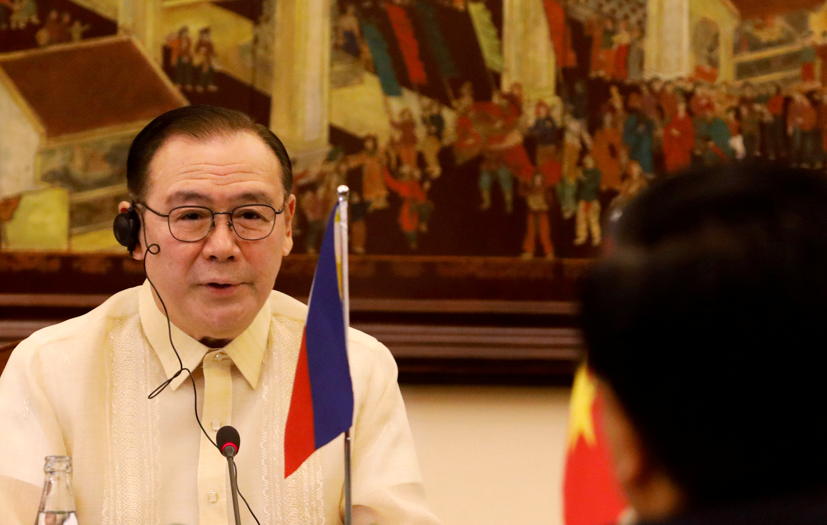 Philippines' Foreign Affairs Secretary Teodoro Locsin is seen during a talk with Vietnam's Deputy Prime Minister and Foreign Minister Pham Binh Minh at the Government Guesthouse in Hanoi, Vietnam July 8, 2019. REUTERS/Kham