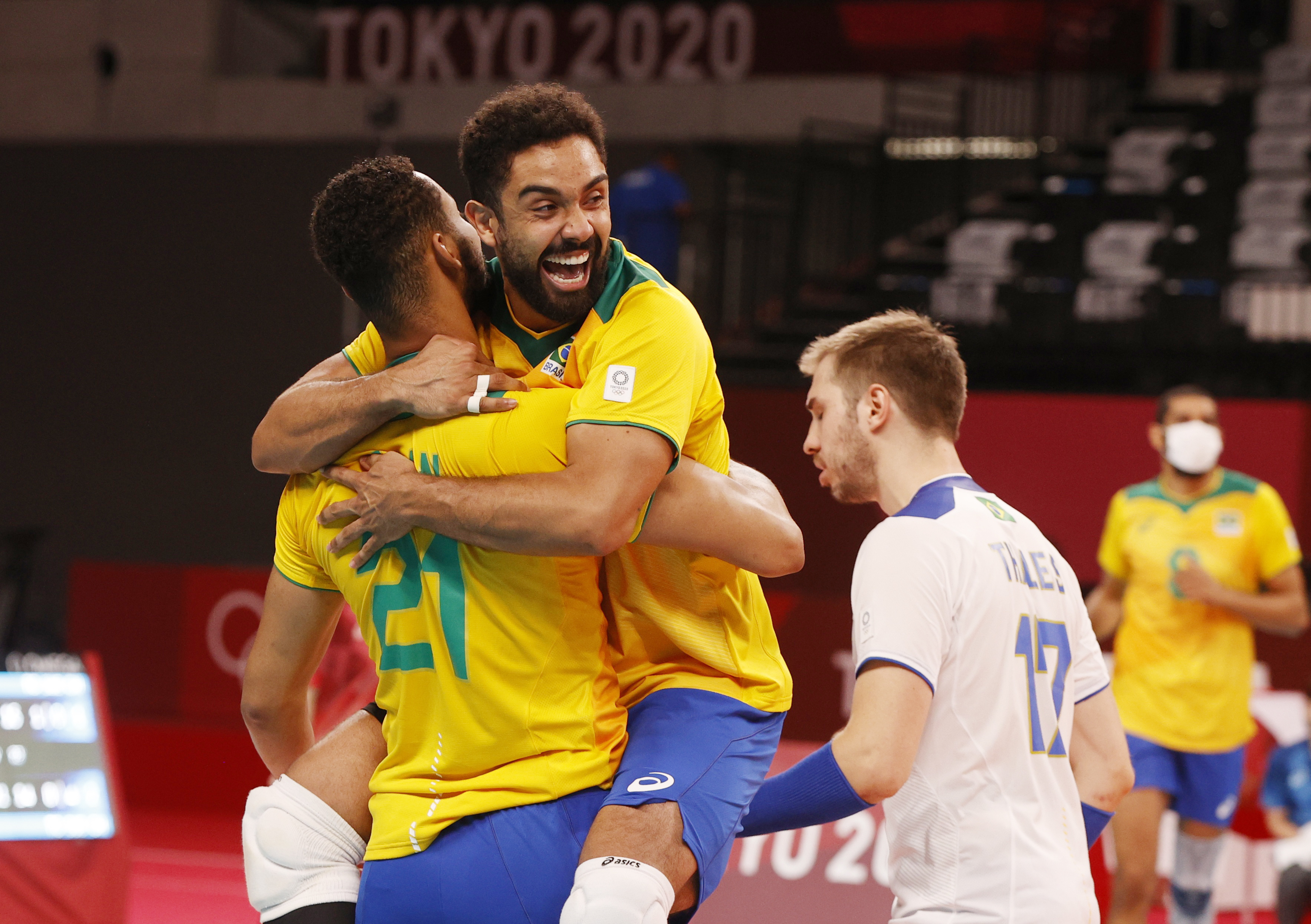 Tokyo 2020 Olympics - Volleyball - Men's Pool B - Brazil v Argentina - Ariake Arena, Tokyo, Japan – July 26, 2021. Fernando of Brazil and Alan of Brazil celebrate. REUTERS/Valentyn Ogirenko