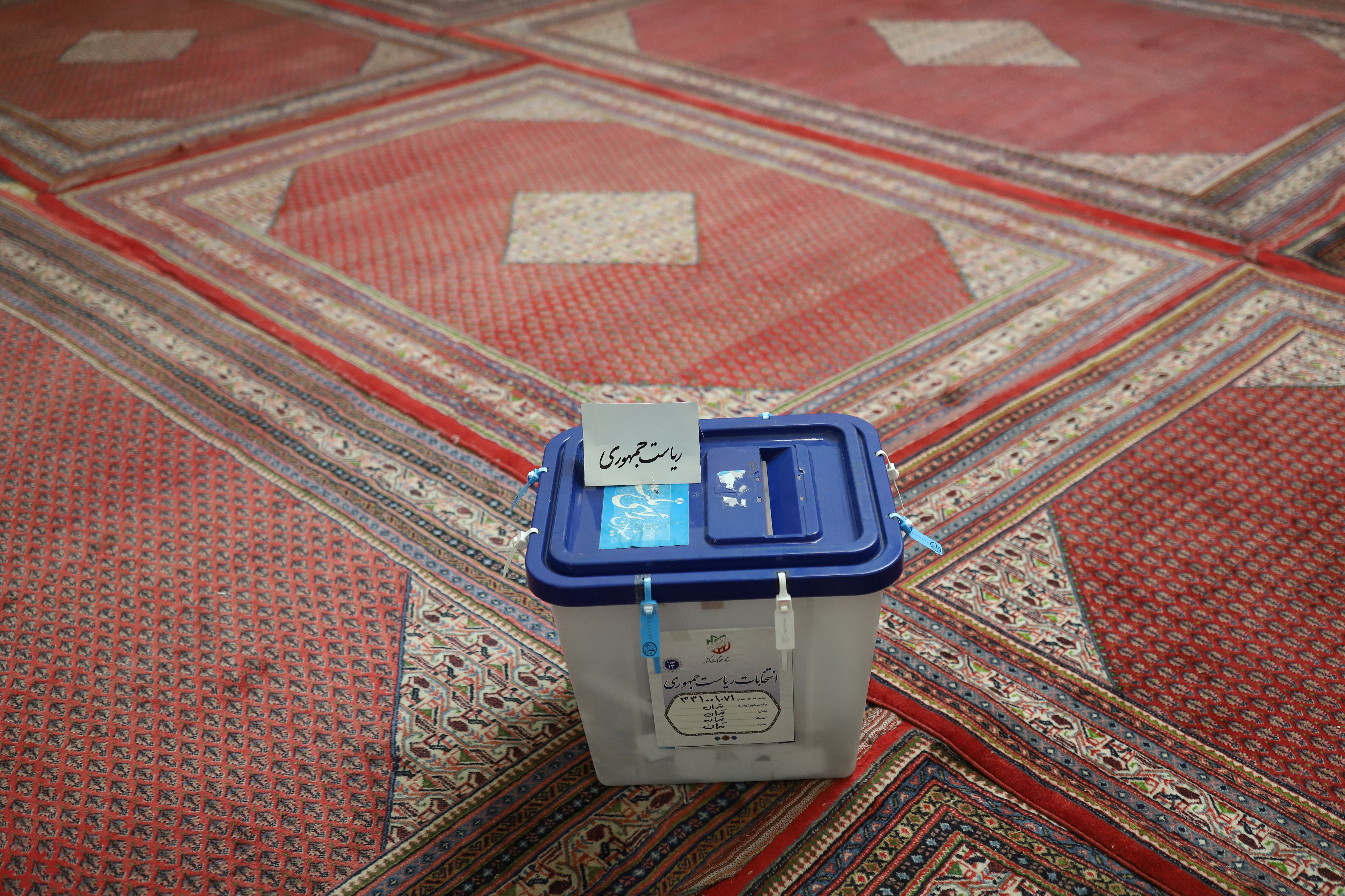 A ballot box is seen at a polling station after voting ended in the presidential election in Tehran, Iran June 19, 2021. Majid Asgaripour/WANA (West Asia News Agency) via REUTERS
