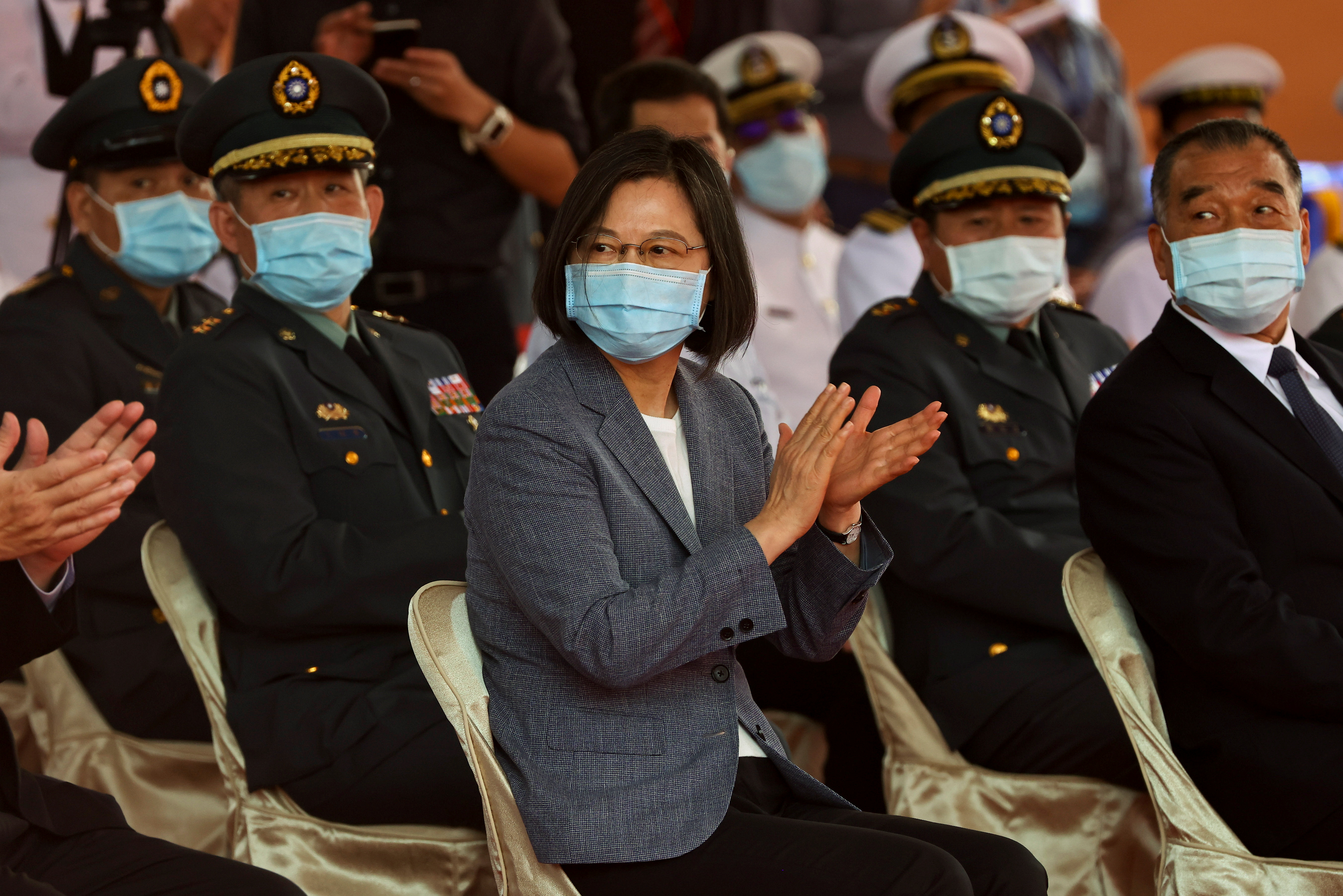Taiwan's President Tsai Ing-wen applauds during the launch ceremony for Taiwan Navy's domestically built amphibious transport dock