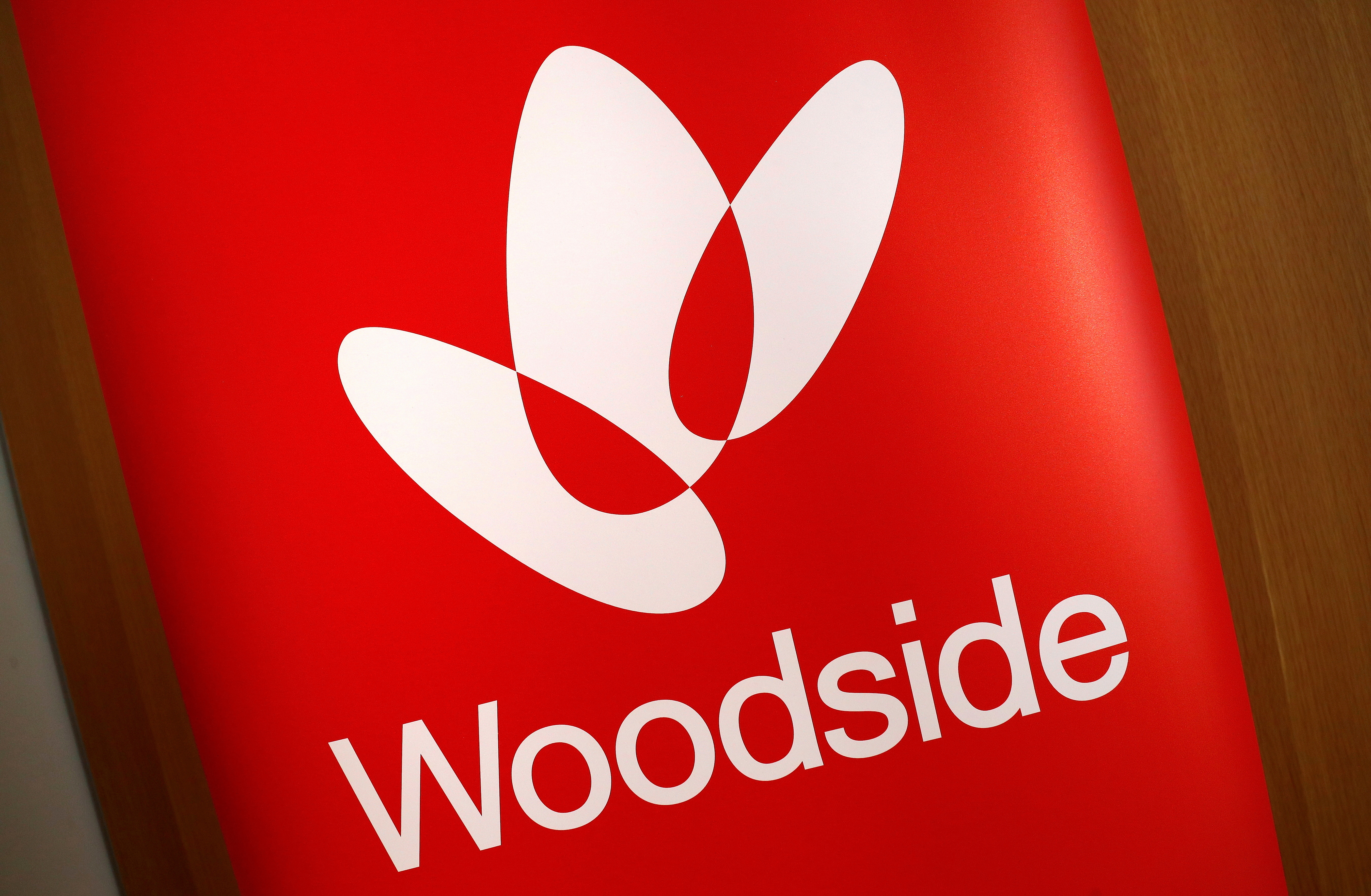 The logo for Woodside Petroleum, Australia's top independent oil and gas company, adorns a promotional poster on display at a briefing for investors in Sydney, Australia, May 23, 2018.   REUTERS/David Gray/File Photo