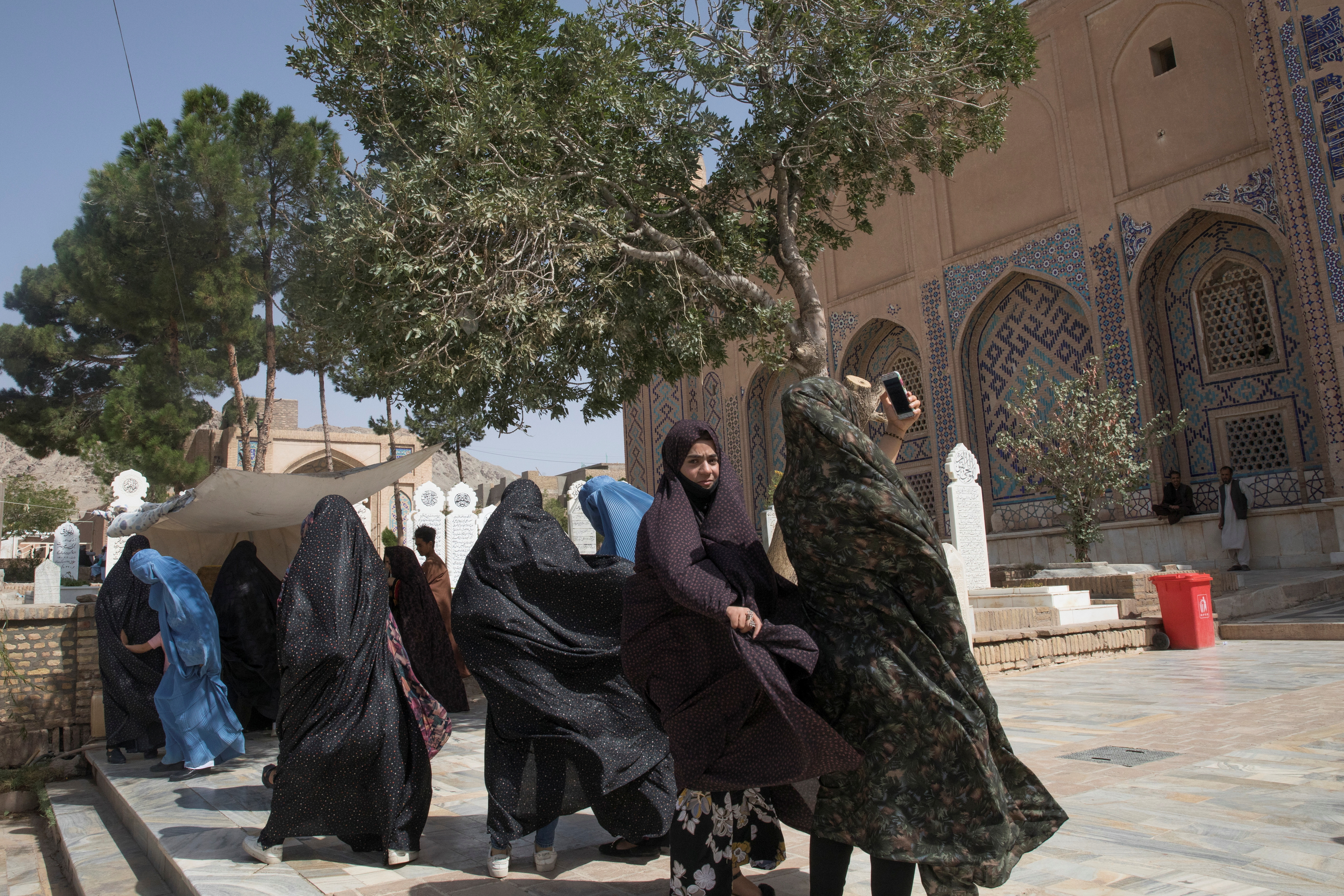 Afghan women walk at a mosque in Herat, Afghanistan September 10, 2021. WANA (West Asia News Agency) via REUTERS