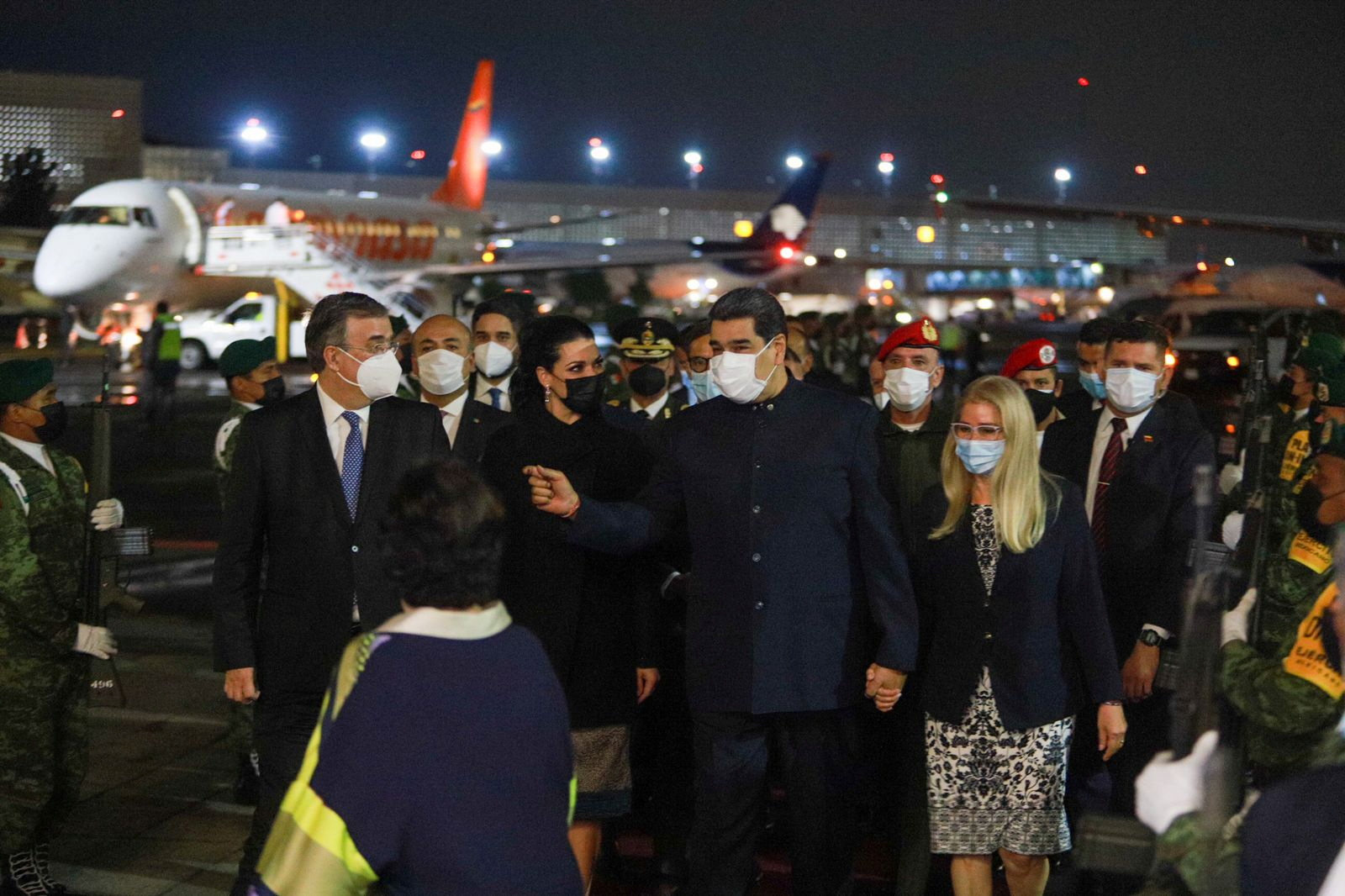 Mexico's Foreign Relations Minister Marcelo Ebrard chats with Venezuelan President Nicolas Maduro, flanked by his wife Rosalinda Bueso and National Assembly member and first lady Cilia Flores, at the Benito Juarez International airport ahead of the summit of the Community of Latin American and Caribbean States (CELAC), in Mexico City, Mexico September 17, 2021. Mexico's Foreign Relations Ministry/Handout via REUTERS