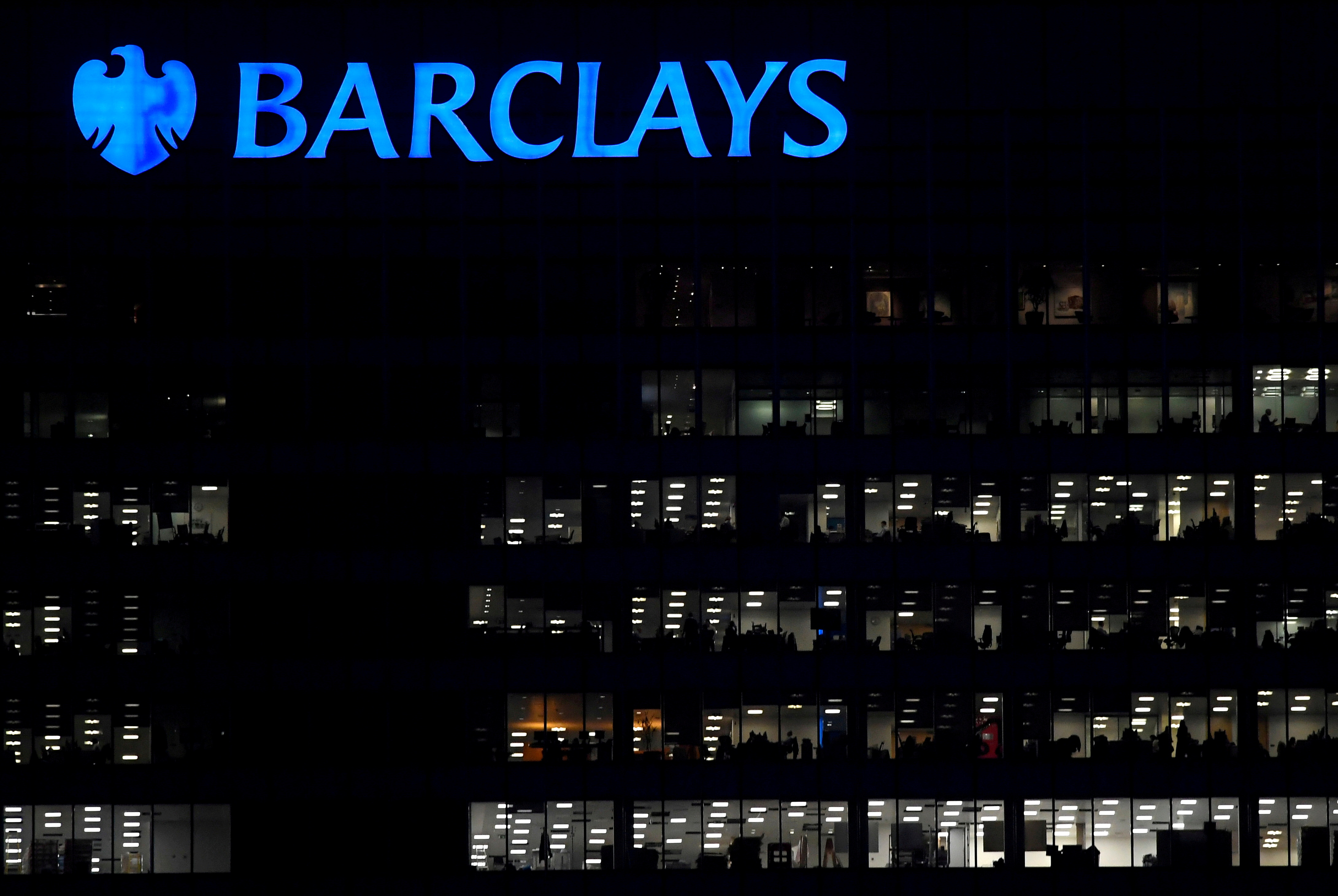 Workers are seen at Barclays bank offices in the Canary Wharf financial district in London, Britain, November 17, 2017.  REUTERS/Toby Melville/File Photo