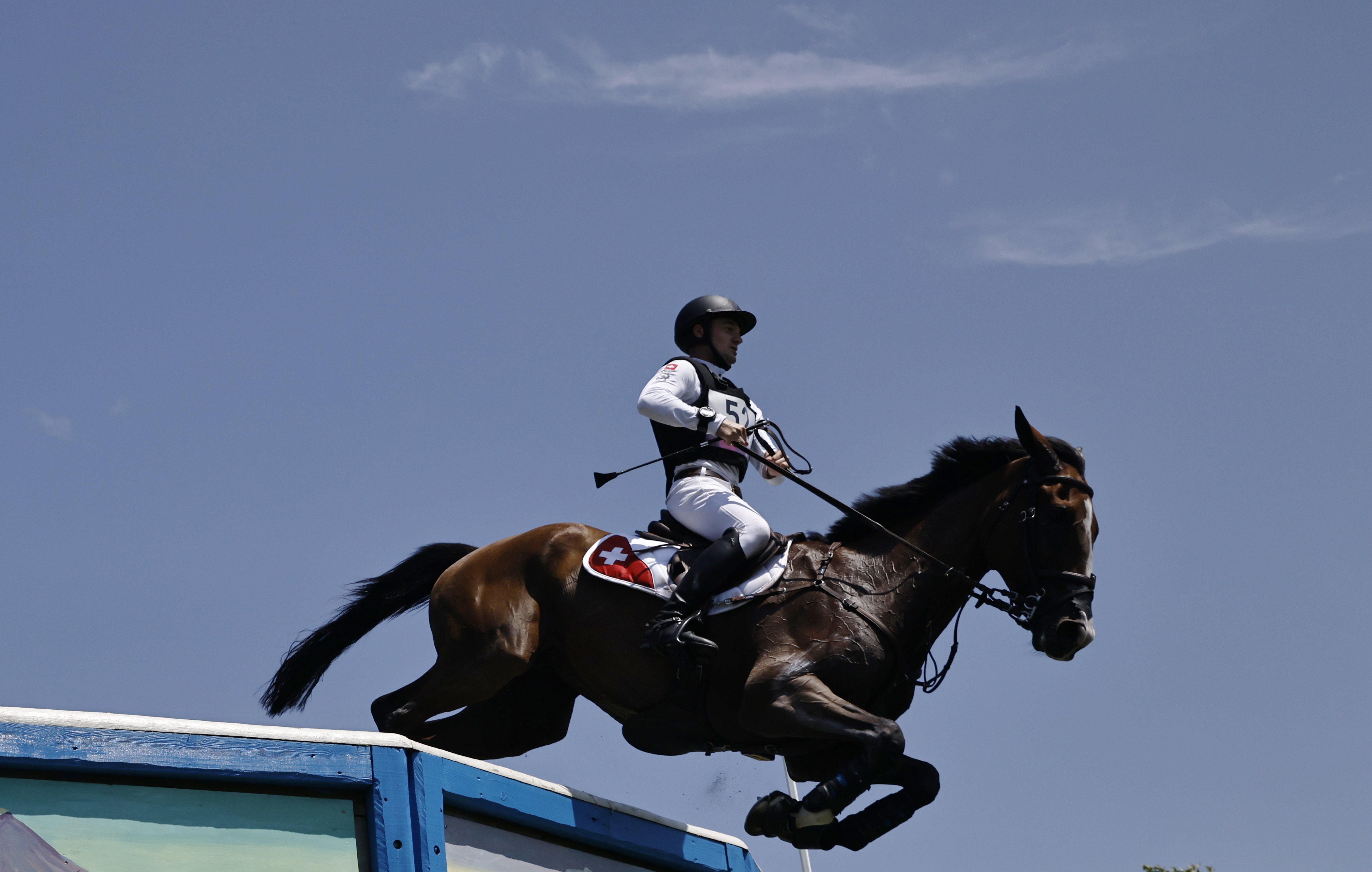 Tokyo 2020 Olympics - Equestrian - Eventing - Cross Country Team - Final - Sea Forest XC Course - Tokyo, Japan - August 1, 2021. Robin Godel of Switzerland on his horse Jet Set compete REUTERS/Alkis Konstantinidis