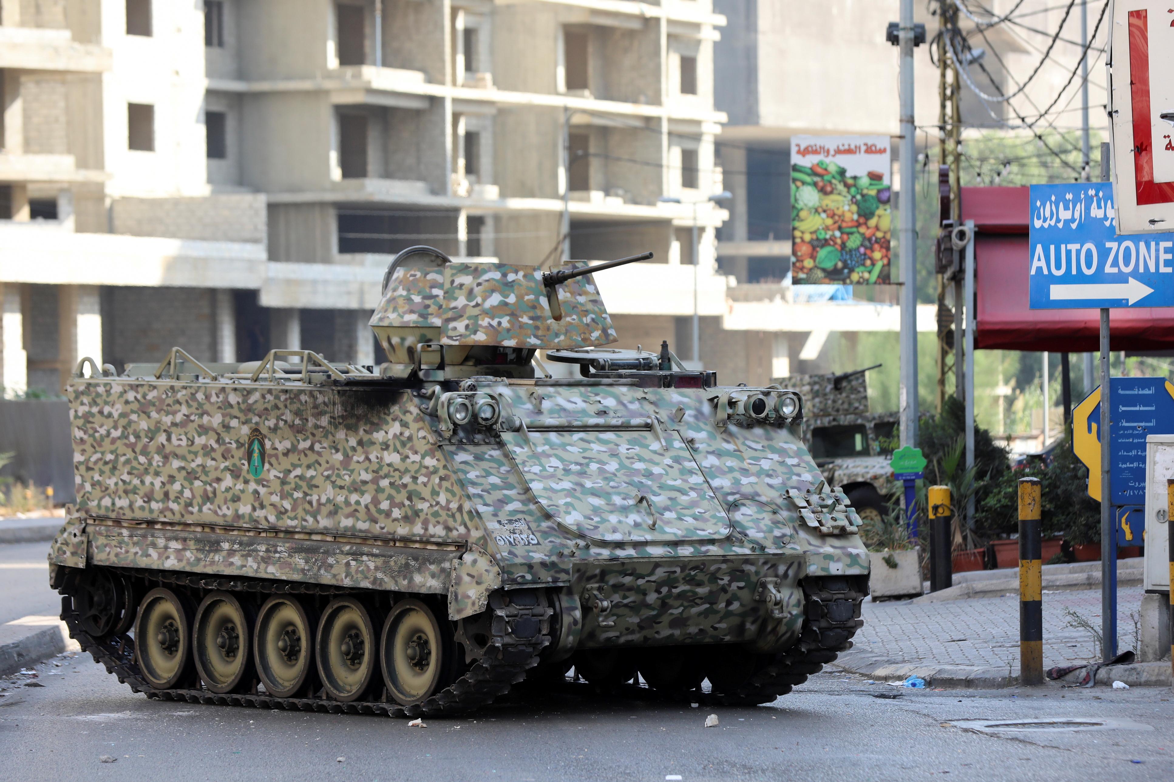 A tank is seen after gunfire erupted, in Beirut, Lebanon October 14, 2021.  REUTERS/Mohamed Azakir