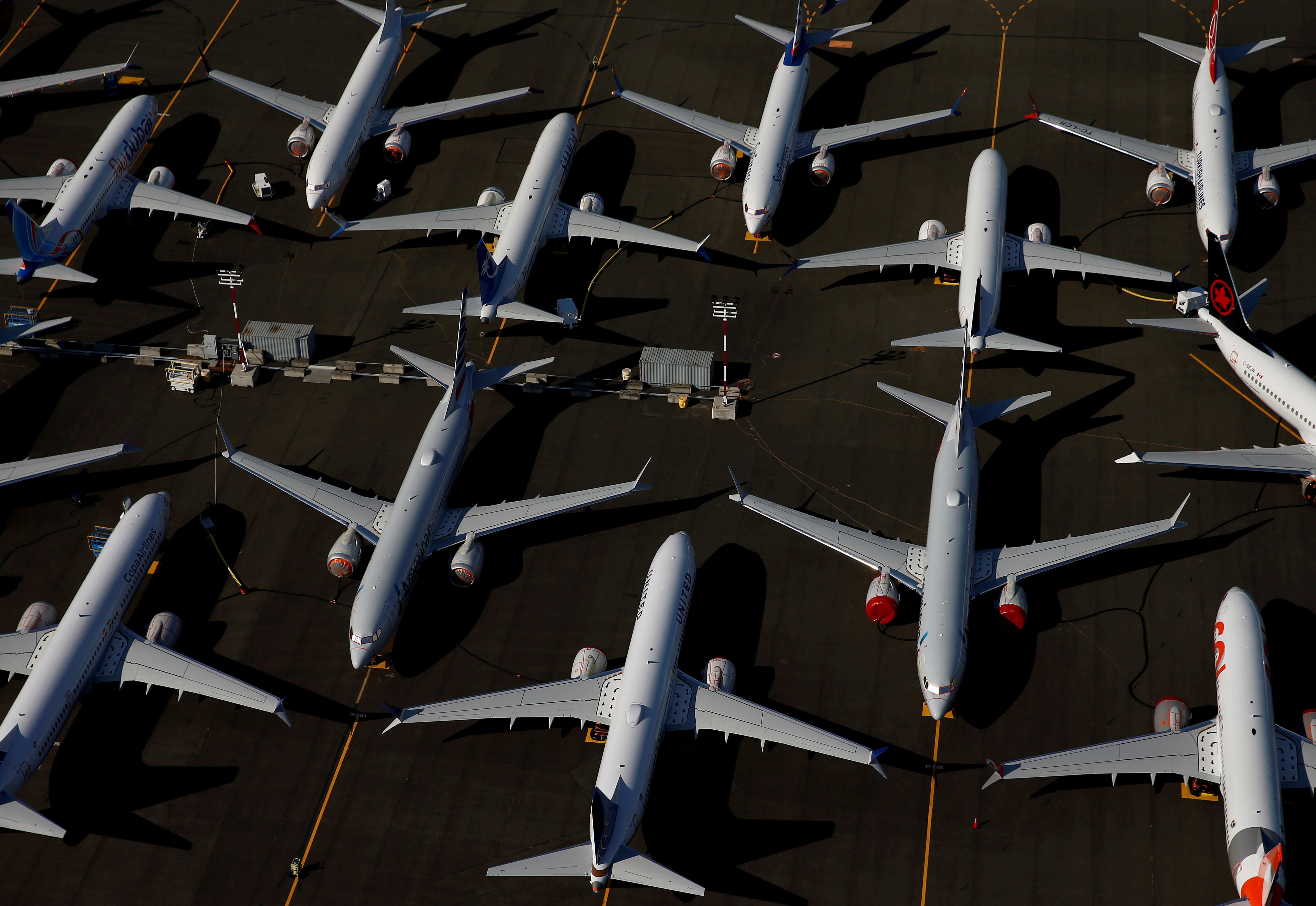 Grounded Boeing 737 MAX aircraft are seen parked in an aerial photo at Boeing Field in Seattle, Washington, U.S. July 1, 2019. REUTERS/Lindsey Wasson/File Photo