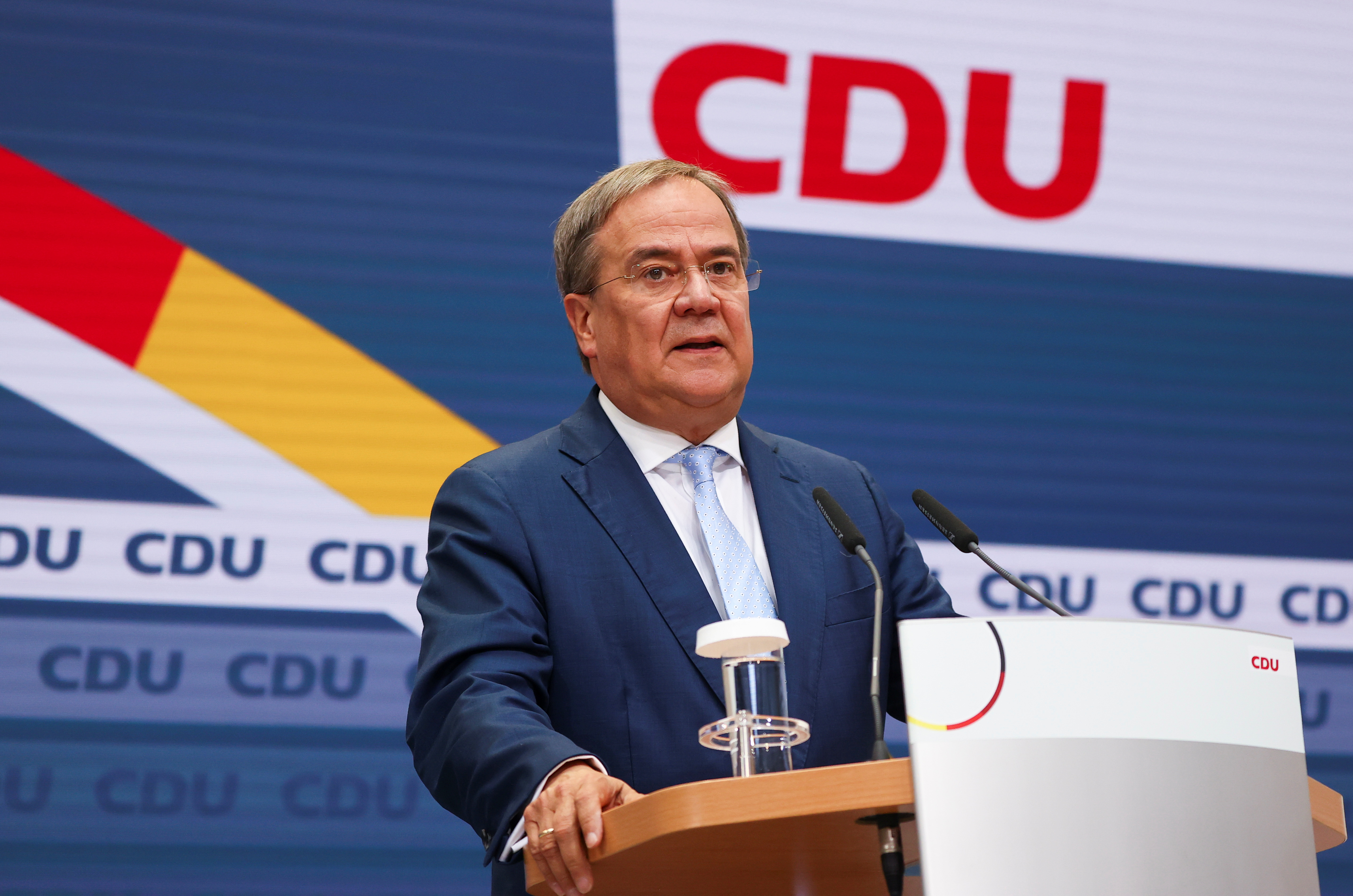 Christian Democratic Union (CDU) leader and top candidate for chancellor Armin Laschet holds a news conference, one day after the German general elections, in Berlin, Germany, September 27, 2021. REUTERS/Fabrizio Bensch