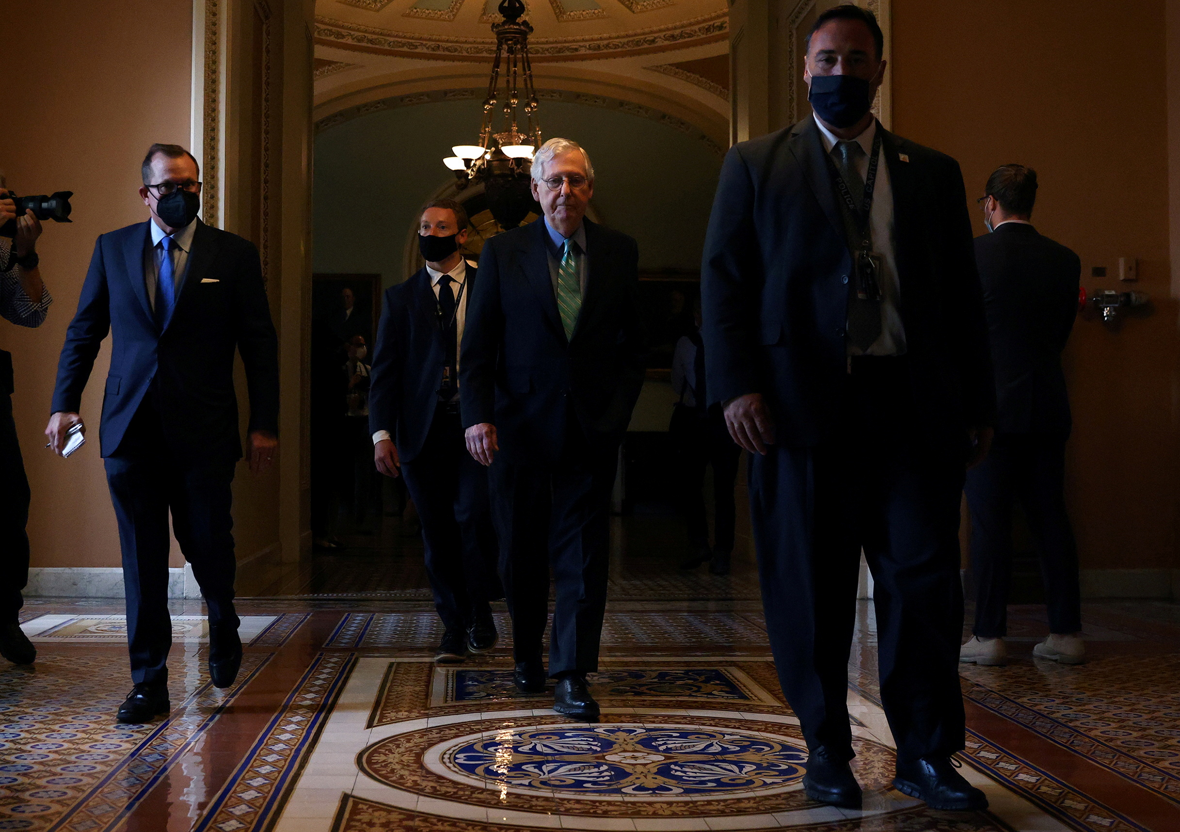 U.S. Senate Republican Leader Mitch McConnell (R-KY) walks to his office after it was announced that the U.S. Senate reached a deal to pass a $480 billion increase in Treasury Department borrowing authority, at the U.S. Capitol in Washington, U.S., October 7, 2021. REUTERS/Leah Millis