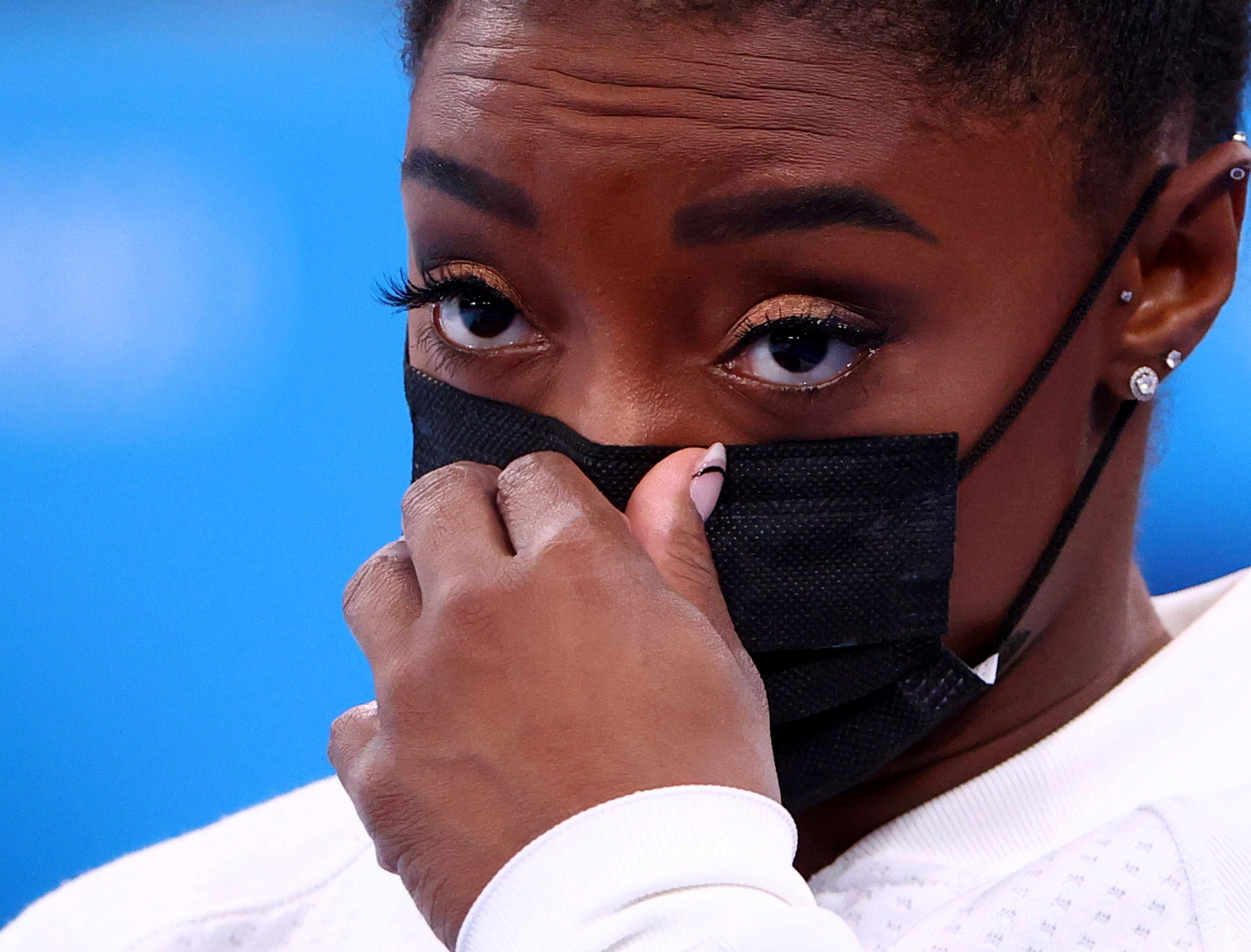 Tokyo 2020 Olympics - Gymnastics - Artistic - Women's Team - Final - Ariake Gymnastics Centre, Tokyo, Japan - July 27, 2021.  Simone Biles of the United States wearing a protective face mask gestures. REUTERS/Lindsey Wasson/File Photo