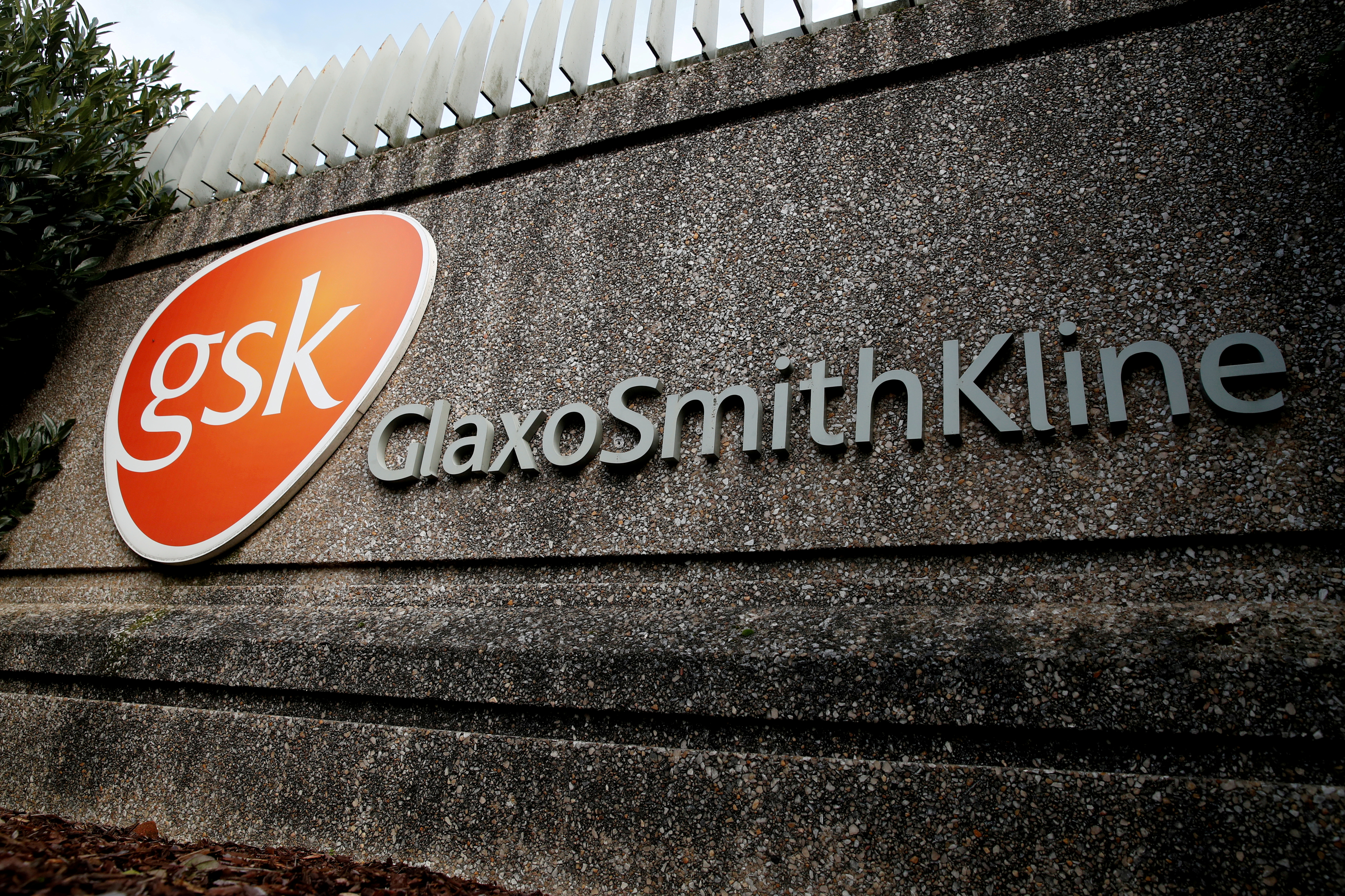 Company logo of pharmaceutical company GlaxoSmithKline is seen at their Stevenage facility, Britain October 26, 2020. REUTERS/Matthew Childs//File Photo