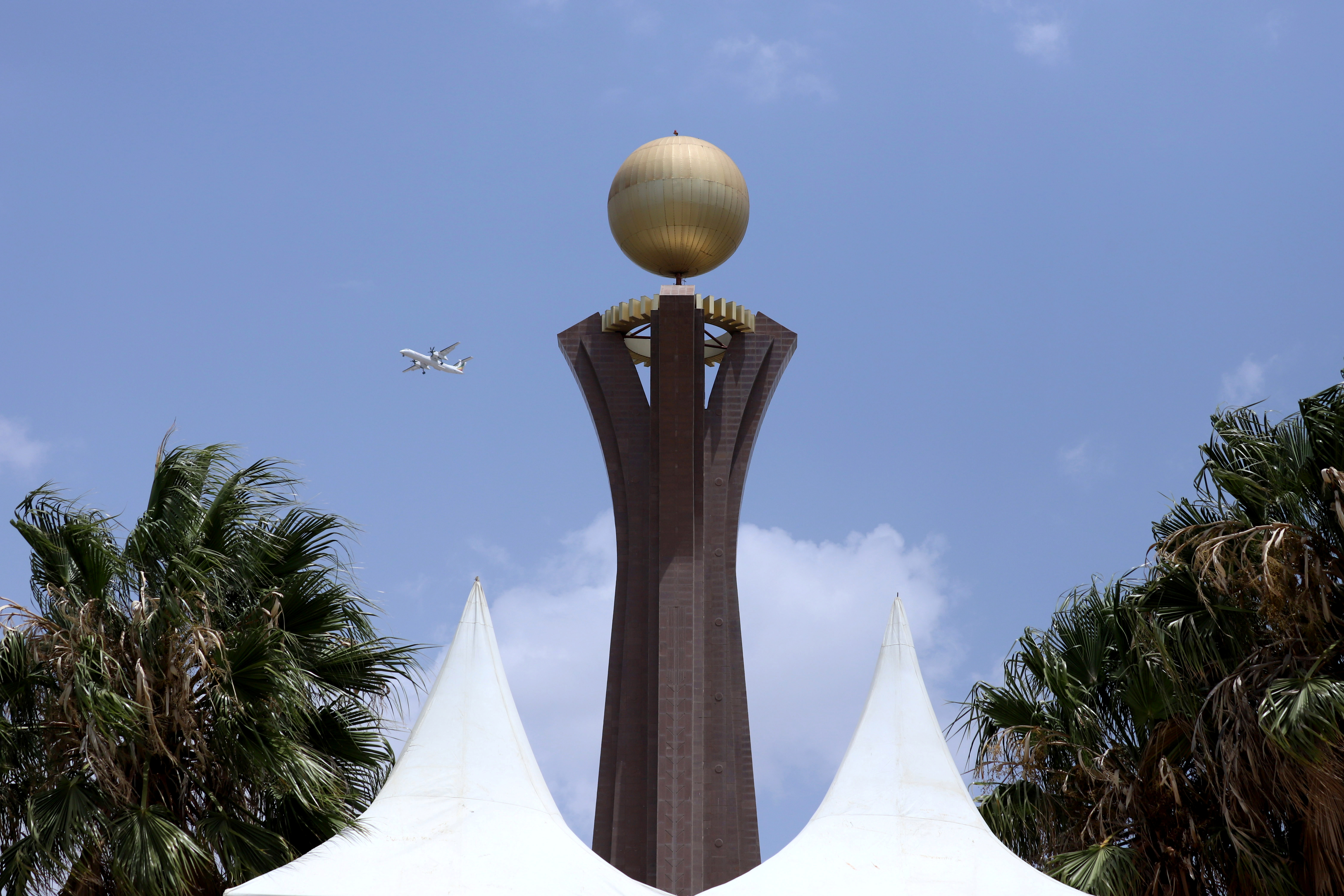 A plane flies next to Tigray Martyrs' monument during the funeral ceremony of Ethiopia's Army Chief of Staff Seare Mekonnen in Mekele, Tigray Region, Ethiopia June 26, 2019.  REUTERS/Tiksa Negeri