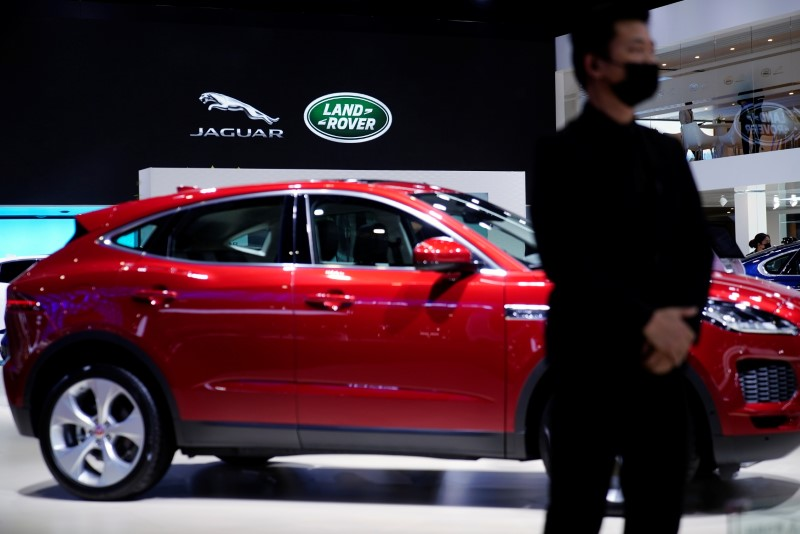 A staff member stands at the Jaguar Land Rover booth during a media day for the Auto Shanghai show in Shanghai, China April 20, 2021. REUTERS/Aly Song