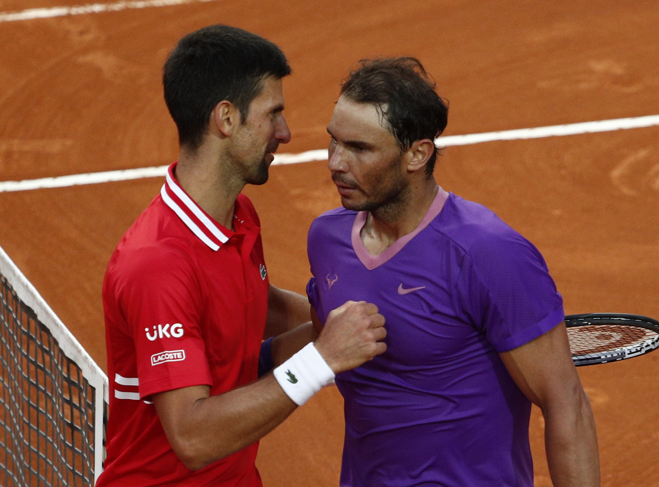 Tennis - ATP Masters 1000 - Italian Open - Foro Italico, Rome, Italy - May 16, 2021 Spain's Rafael Nadal shakes hands with Serbia's Novak Djokovic after winning the final REUTERS/Guglielmo Mangiapane