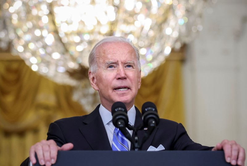 U.S. President Joe Biden discusses his 'Build Back Better' agenda for economic growth and job creation following early morning Senate passage of the bipartisan infrastructure bill and the budget resolution, during a speech in the East Room at the White House in Washington, U.S., August 11, 2021. REUTERS/Evelyn Hockstein