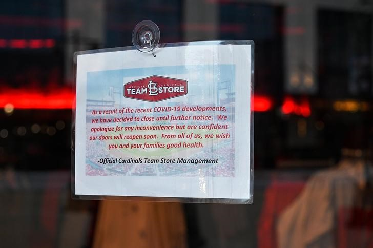 Mar 17, 2020; St. Louis, Missouri, USA;  A sign hangs on the door to the St. Louis Cardinals team store located inside Busch Stadium stating that they are closed due to COVID-19. MLB announced yesterday to push back Opening Day even further after the CDC recommended no events with 50 or more people for eight weeks. Mandatory Credit: Jeff Curry-USA TODAY Sports