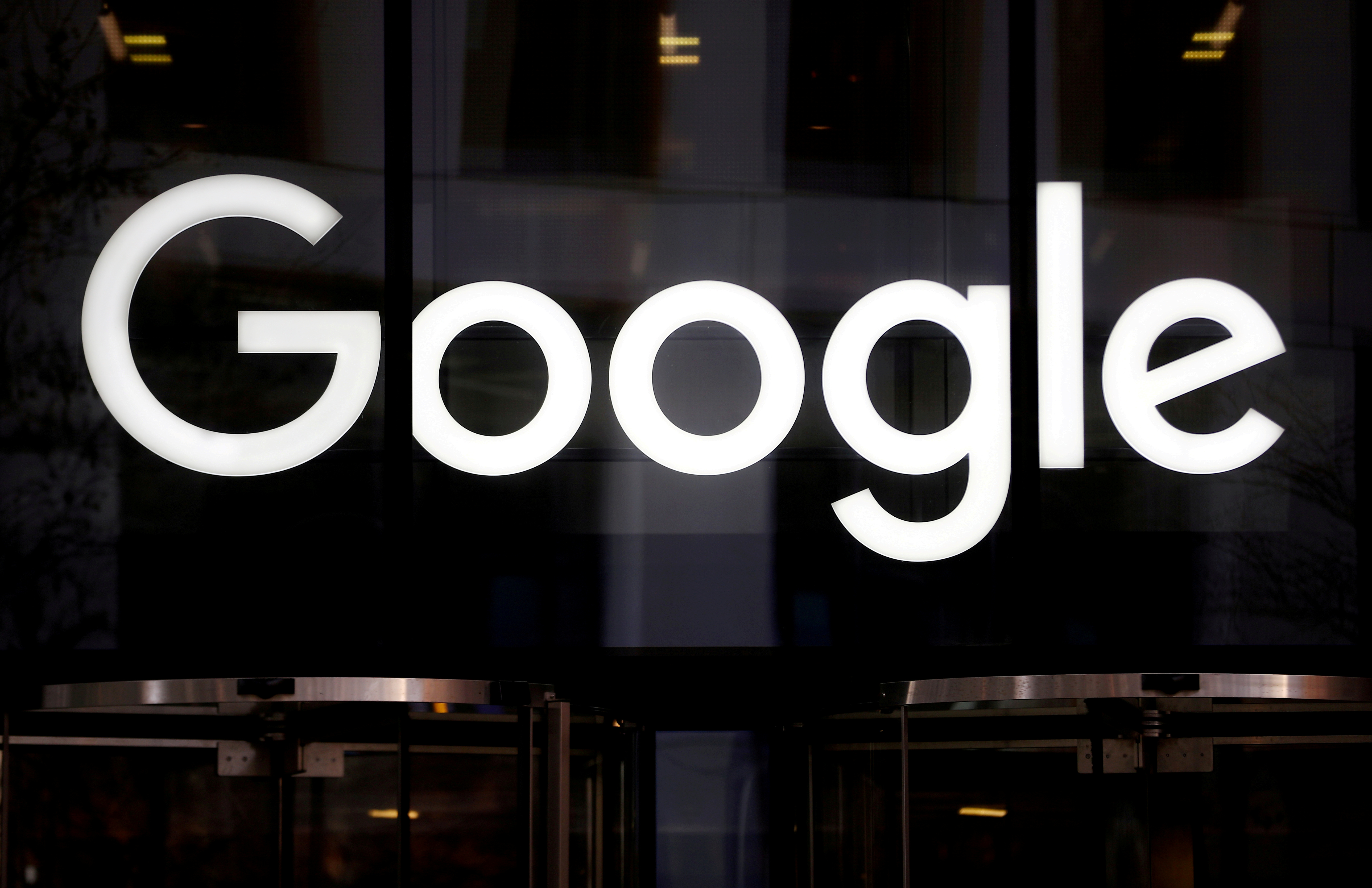 The Google logo is pictured at the entrance to the Google offices in London, Britain January 18, 2019. REUTERS/Hannah McKay