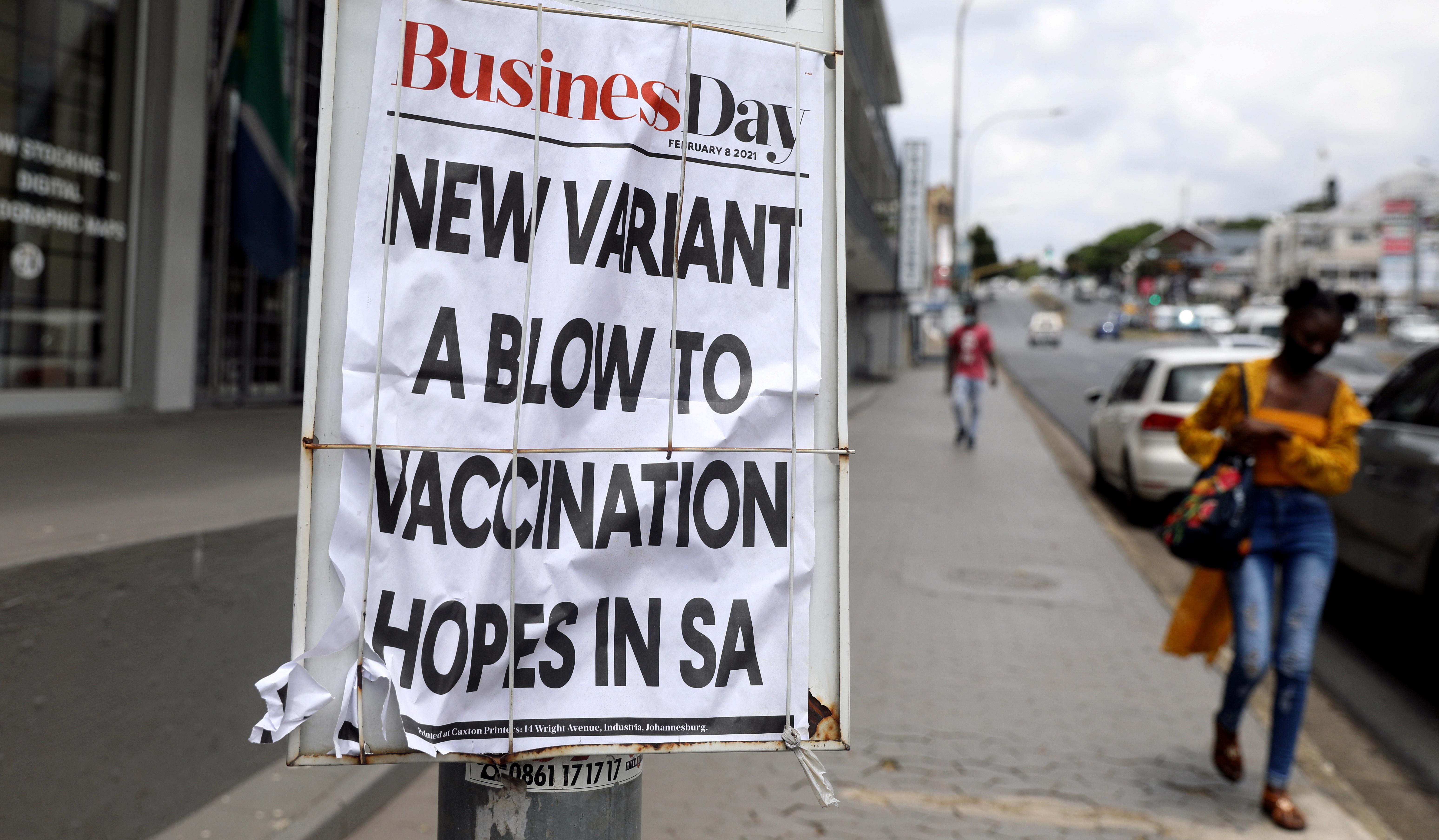 A woman walks past newspaper billboards during the coronavirus disease (COVID-19) outbreak in Johannesburg, South Africa, February 8, 2021. REUTERS/Sumaya Hisham