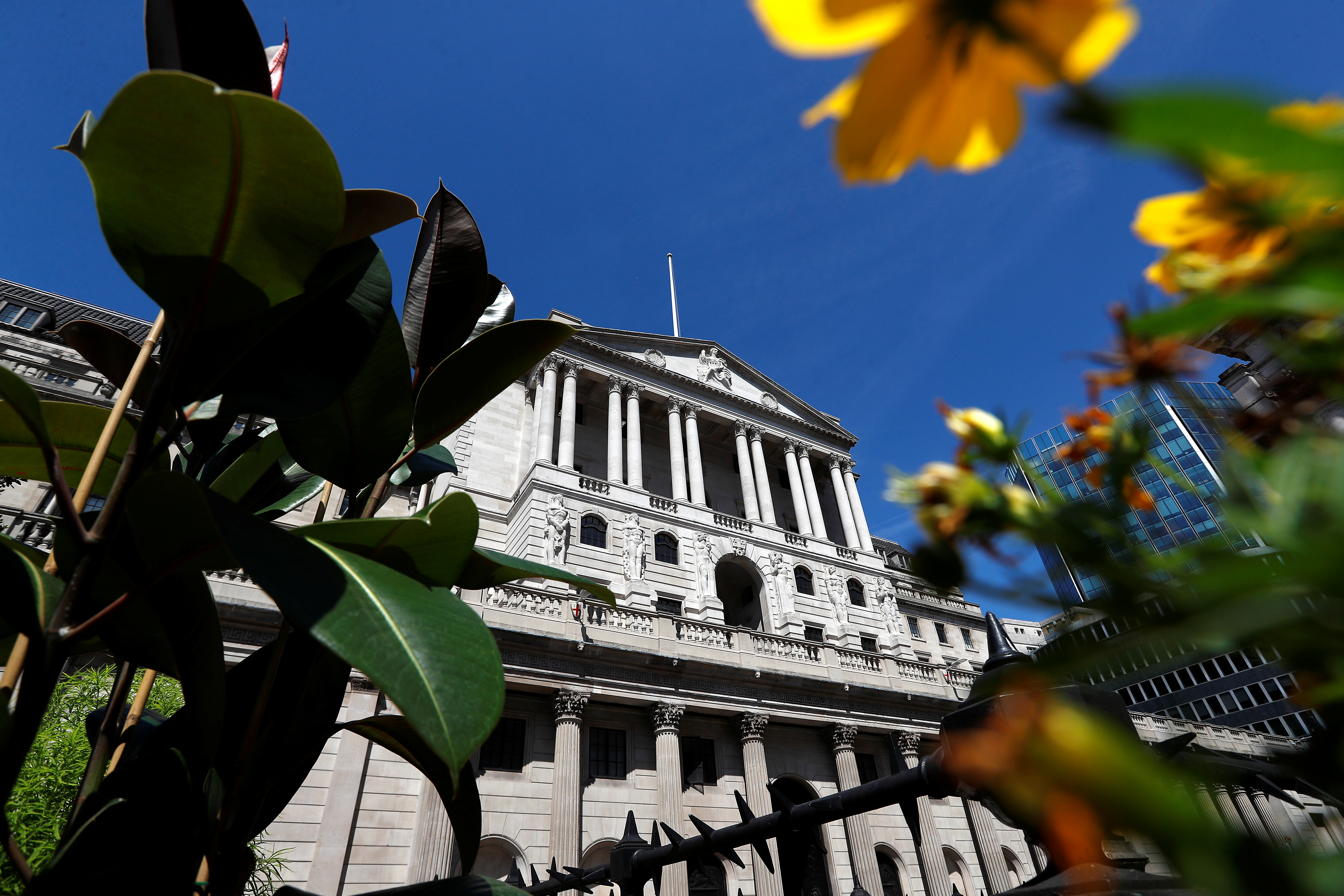 Flowers in bloom are sen opposite the Bank of England, in London, Britain August 1, 2018. REUTERS/Peter Nicholls