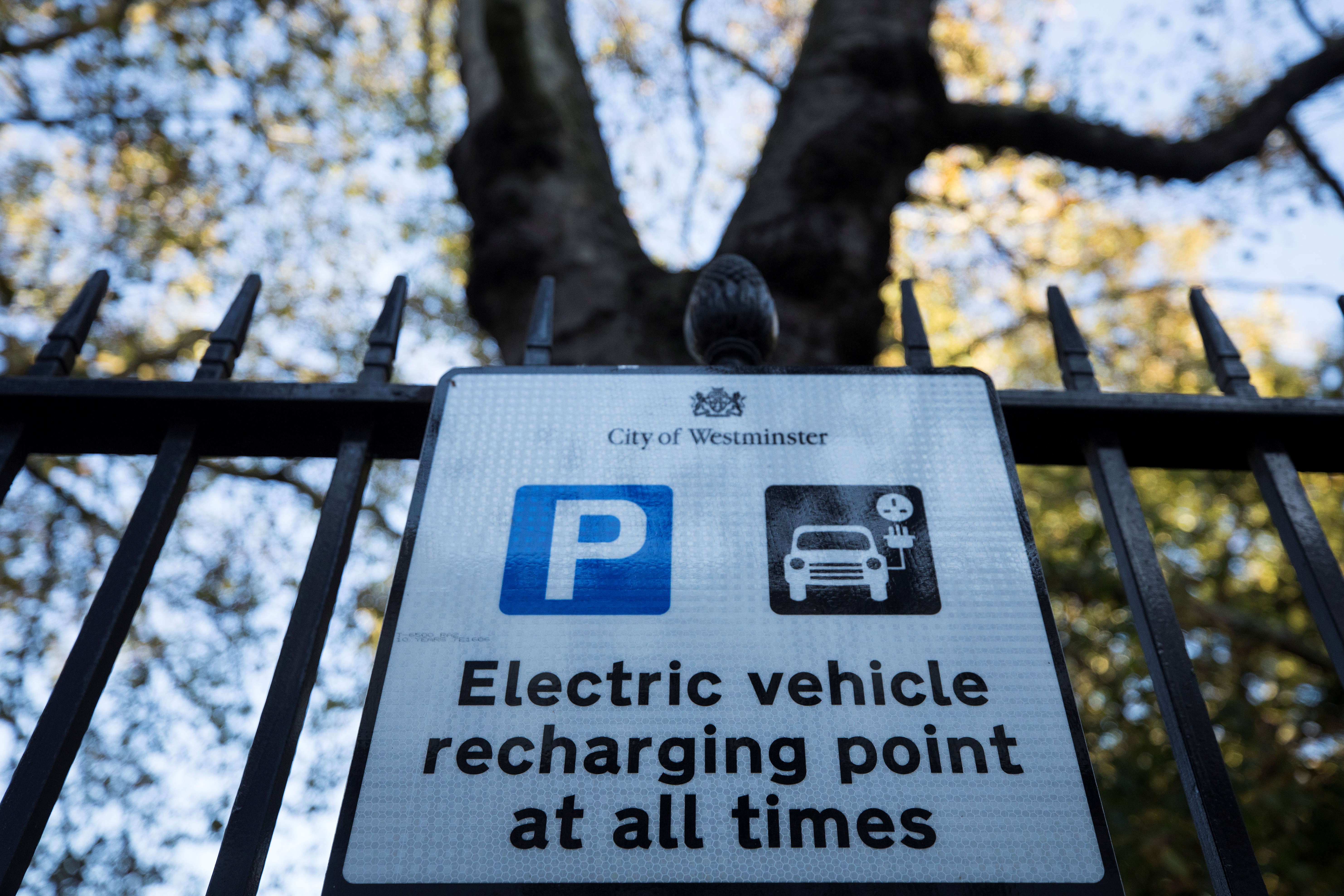 A sign for electric charging points can be seen on display in London, Britain, October 19, 2018. REUTERS/Simon Dawson