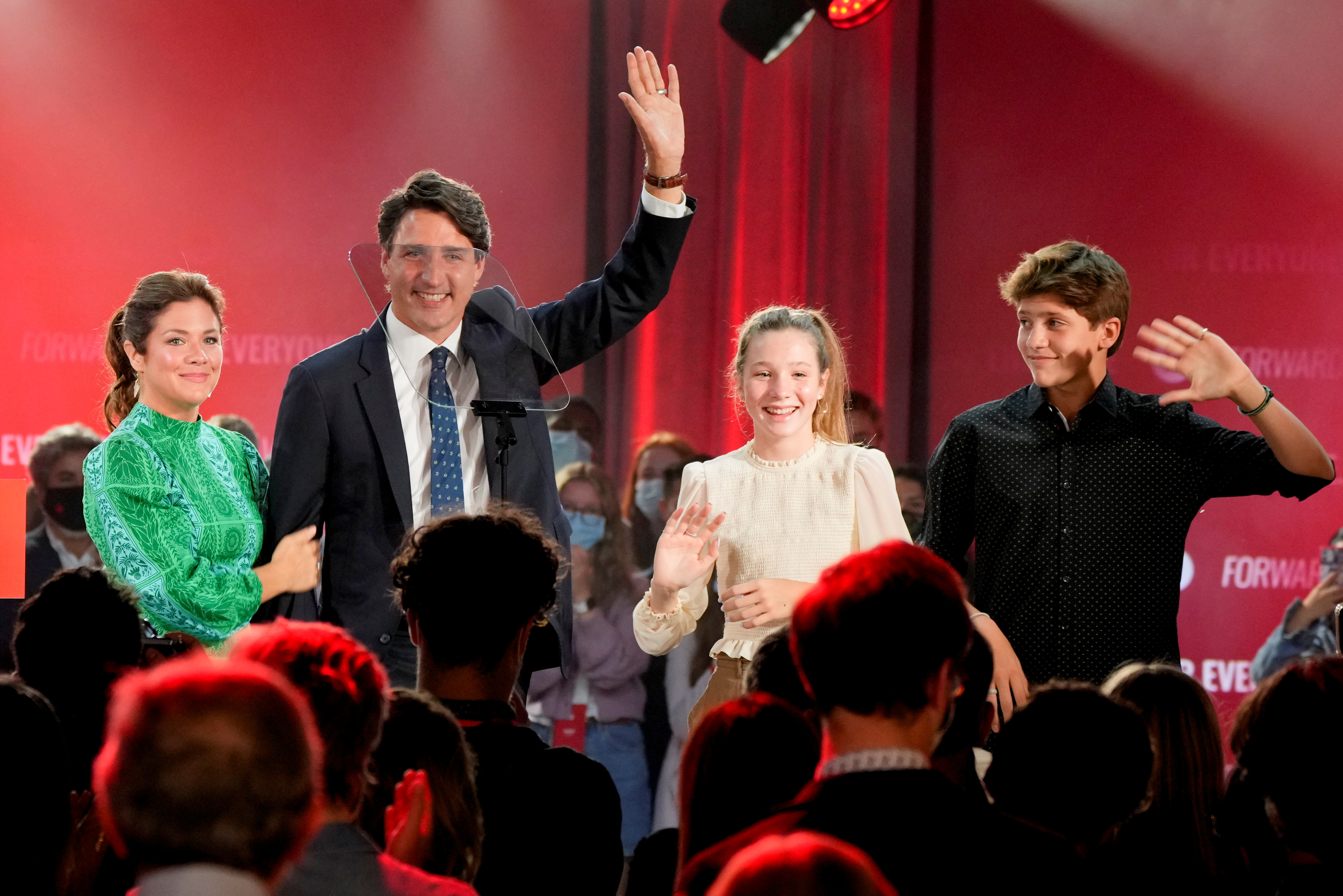 Canada's Liberal Prime Minister Justin Trudeau, accompanied by his wife Sophie Gregoire and their children Ella-Grace and Xavier, waves to supporters during the Liberal election night party in Montreal, Quebec, Canada, September 21, 2021. REUTERS/Carlos Osorio