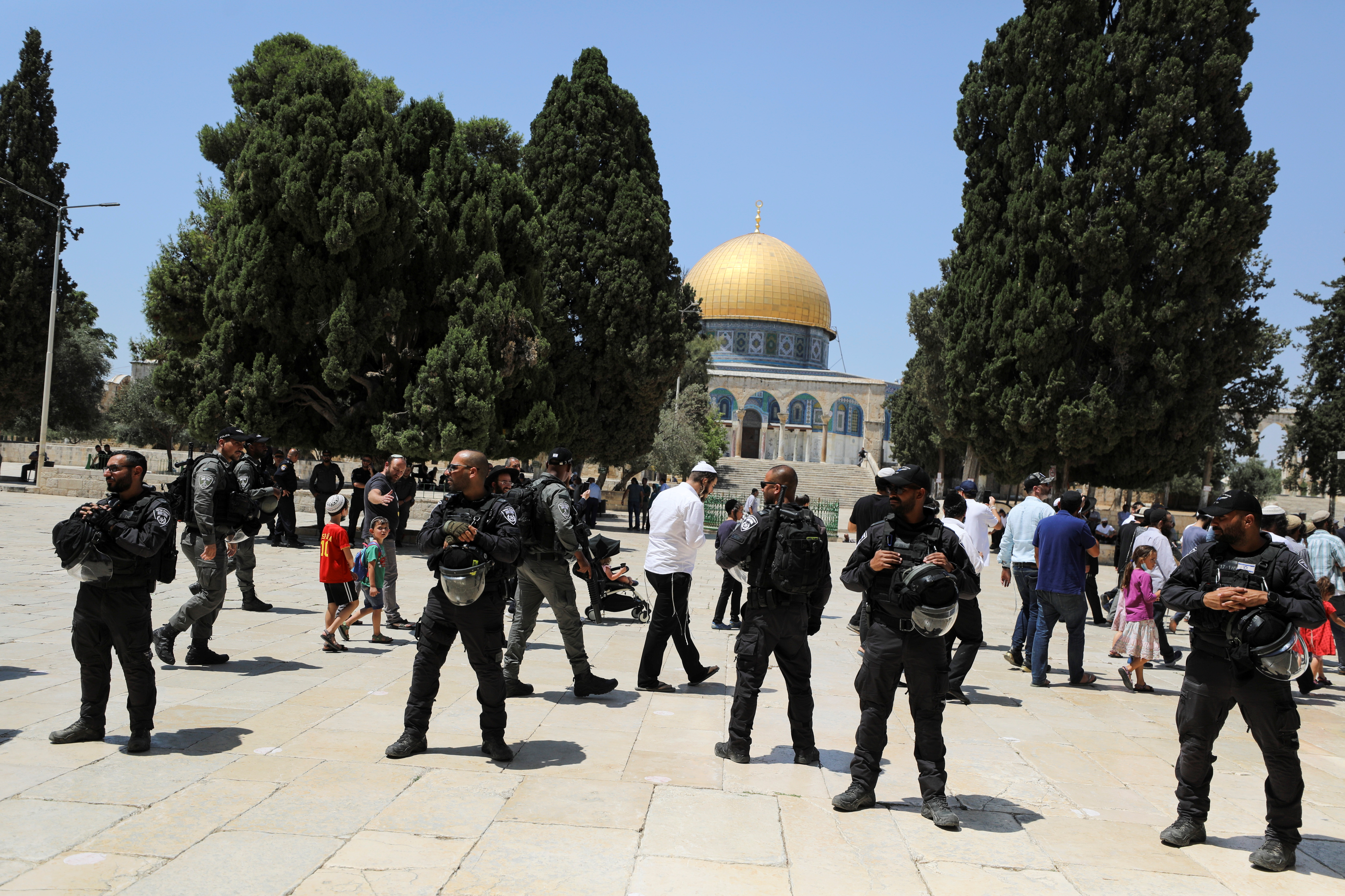 The Dome of the Rock is seen in the background as Israeli security forces guard after brief clashes erupted between Israeli police and Palestinians at al-Aqsa Mosque over visits by Jews on the Tisha B'Av fast day to the compound known to Muslims as Noble Sanctuary and to Jews as Temple Mount, in Jerusalem's Old City, July 18, 2021. REUTERS/Ammar Awad