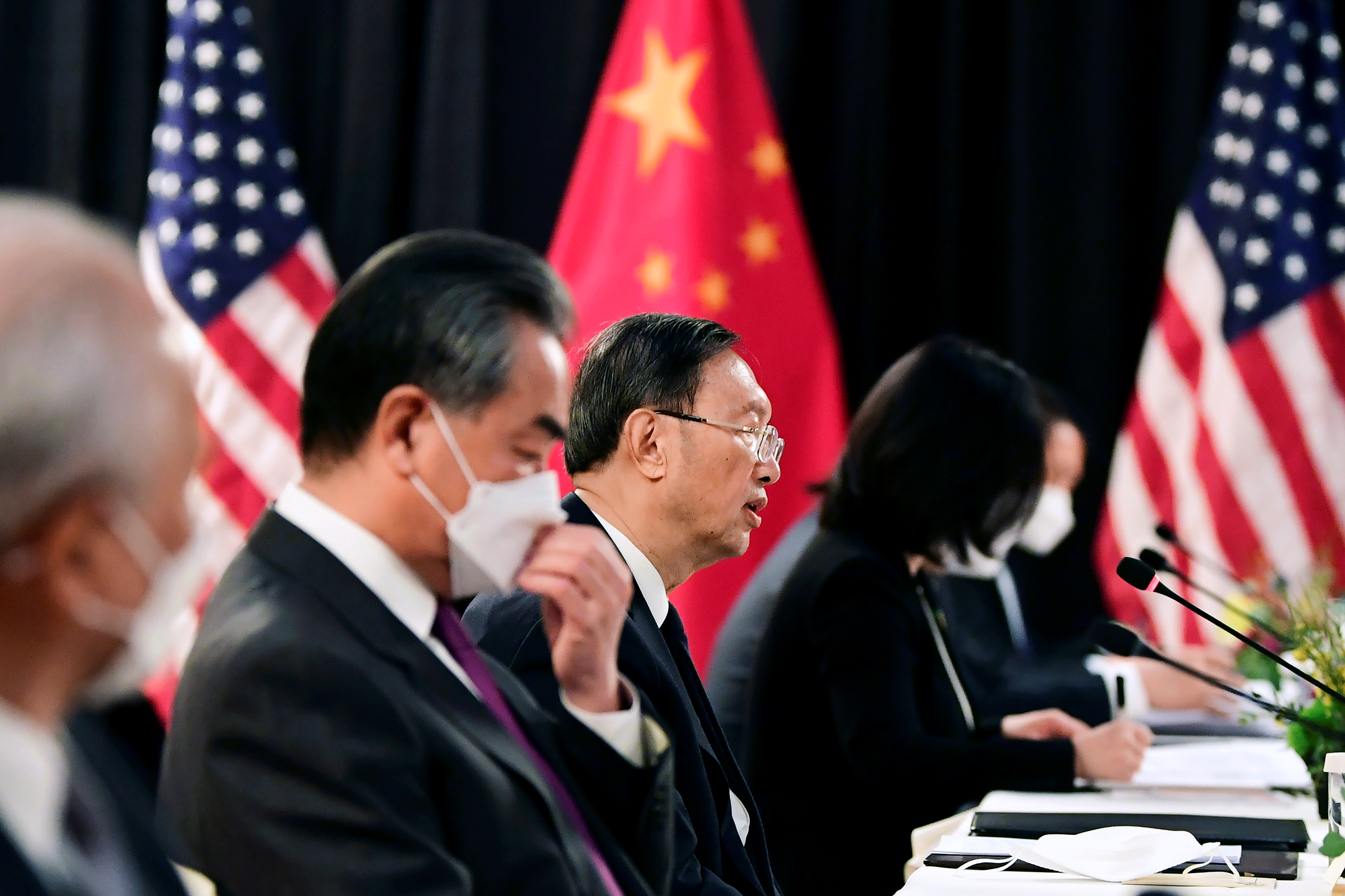 The Chinese delegation led by Yang Jiechi (C), director of the Central Foreign Affairs Commission Office and Wang Yi (2nd L), China's State Councilor and Foreign Minister, speak with their U.S. counterparts at the opening session of U.S.-China talks at the Captain Cook Hotel in Anchorage, Alaska, U.S. March 18, 2021.  Frederic J. Brown/Pool via REUTERS