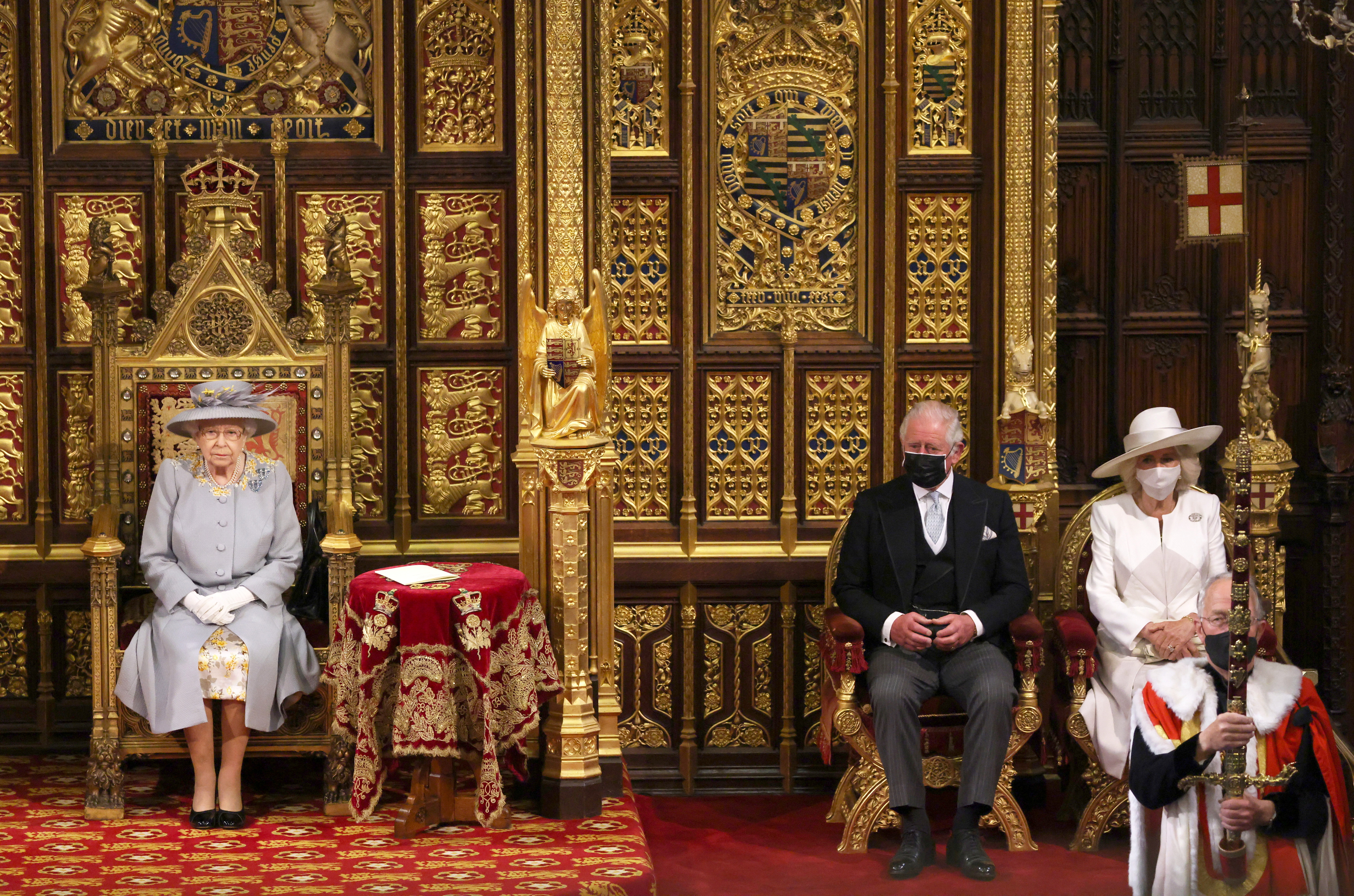 Britain's Queen Elizabeth sits in the House of Lord's Chamber with Prince Charles and Camilla, Duchess of Cornwall for the State Opening of Parliament in London, Britain May 11, 2021. Chris Jackson/Pool via REUTERS