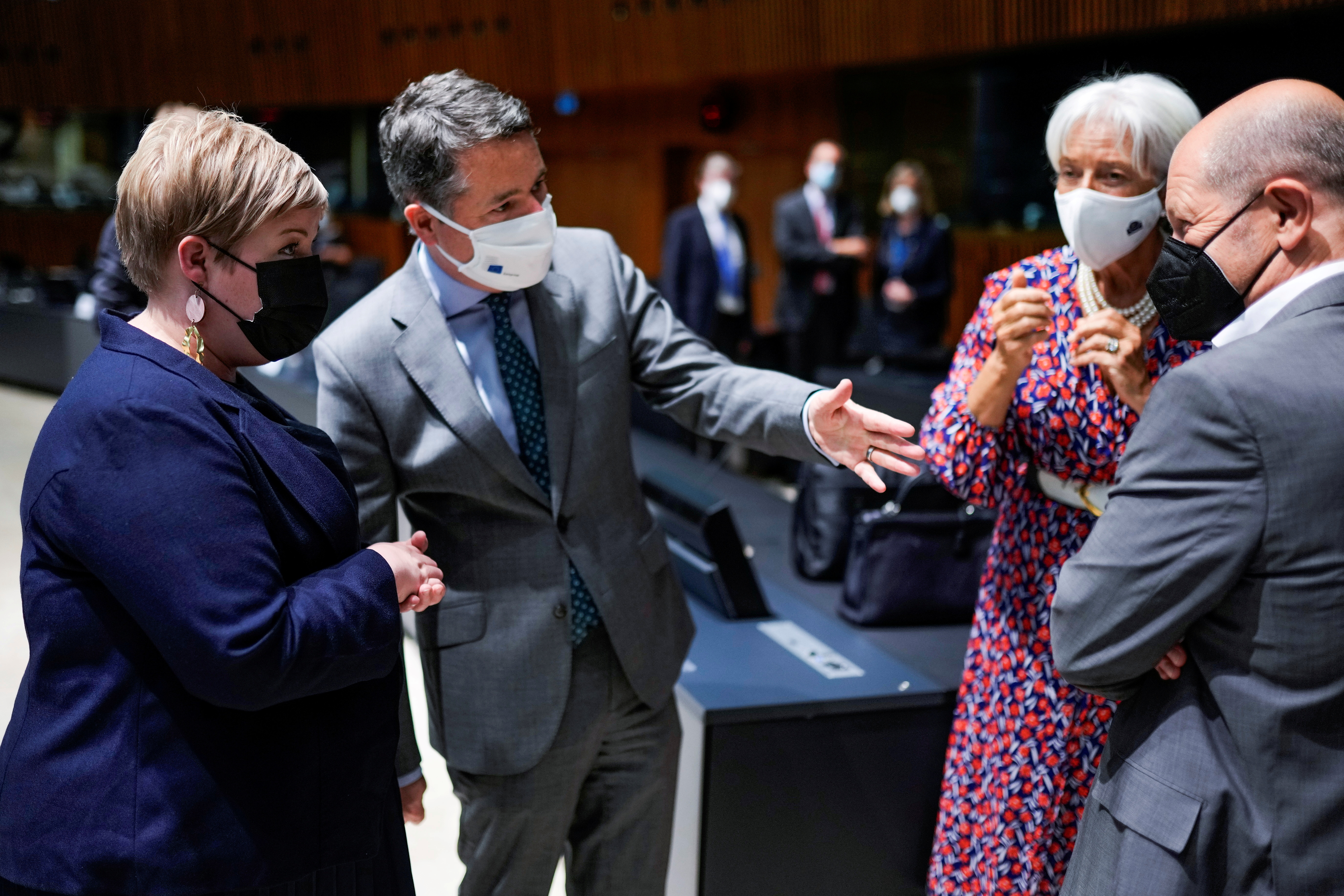 Finland's Finance Minister Annika Saarikko is welcomed by Eurogroup president Paschal Donohoe, European Central Bank President Christine Lagarde, and German Finance Minister Olaf Scholz, during a meeting of Eurogroup Finance Ministers at the European Council building in Luxembourg, Luxembourg June 17, 2021. Francisco Seco/Pool via REUTERS