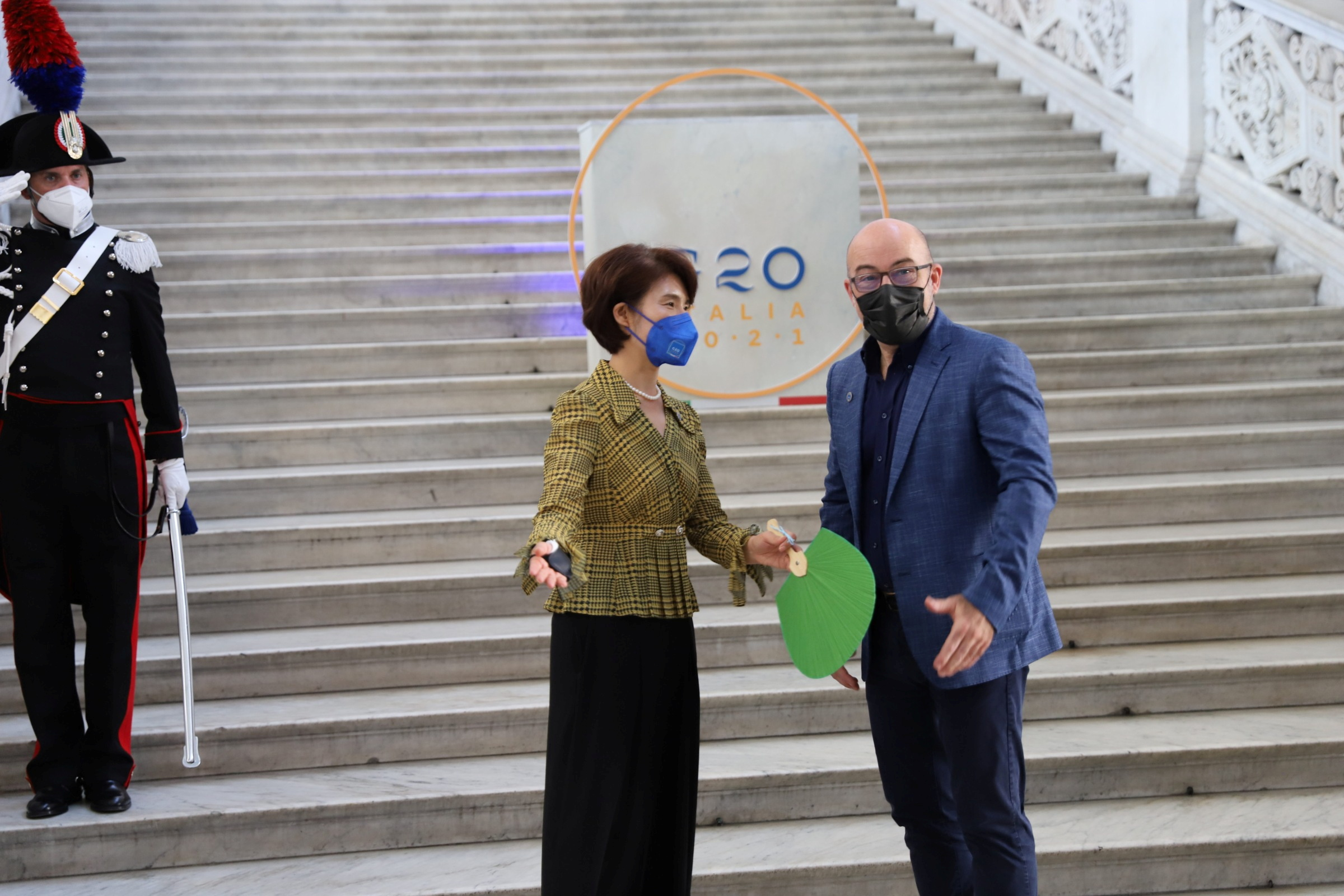 South Korea's Environment Minister Han Jeoung-ae and Italy's Ecological Transition Minister Roberto Cingolani greet one another at the start of the G20 Environment, Climate and Energy Ministers' Meeting in Naples, Italy, July 22, 2021. G20Italy/Handout via REUTERS