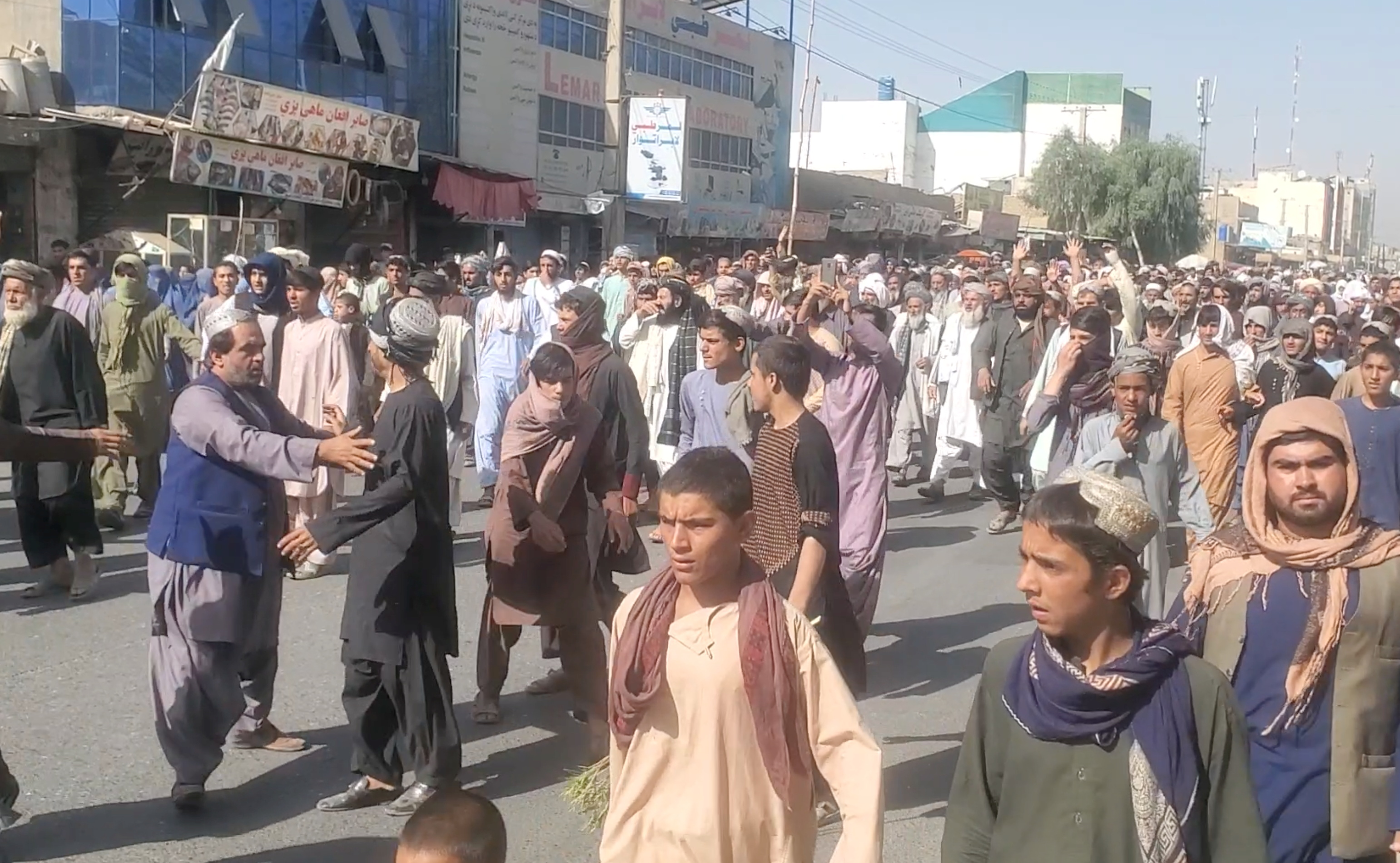 People hold a protest march against the Taliban's decision to force them to leave their homes in Kandahar, Afghanistan September 14, 2021, in this still image taken from video.   ASVAKA News Agency/Handout via REUTERS