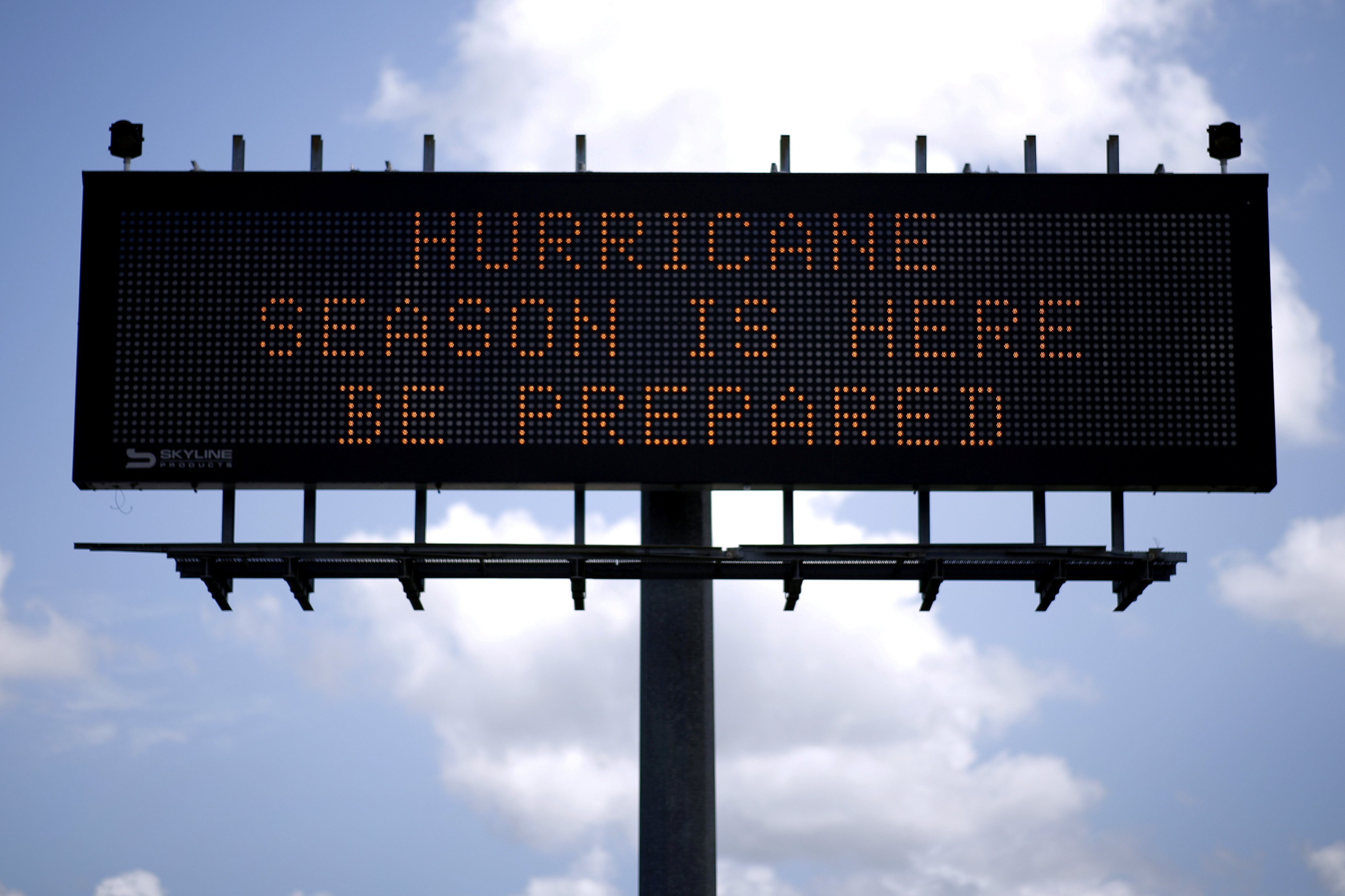 A traffic sign warns of hurricane season in Stowell, Texas, U.S., June 12, 2018. Picture taken June 12, 2018. REUTERS/Jonathan Bachman/File Photo