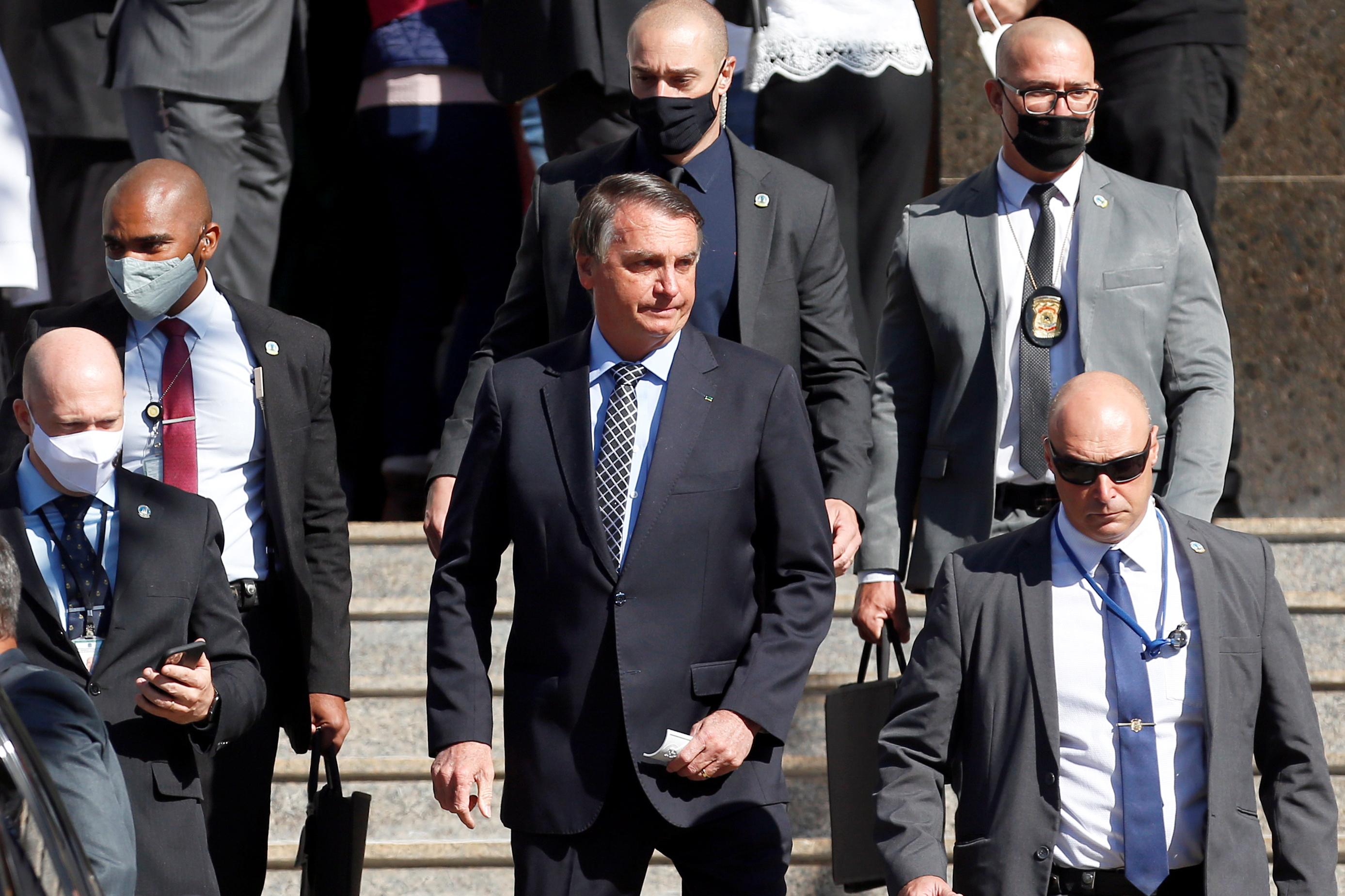 Brazil's President Jair Bolsonaro walks after attending Mass at a Catholic church in Brasilia, Brazil July 1, 2021. REUTERS/Adriano Machado