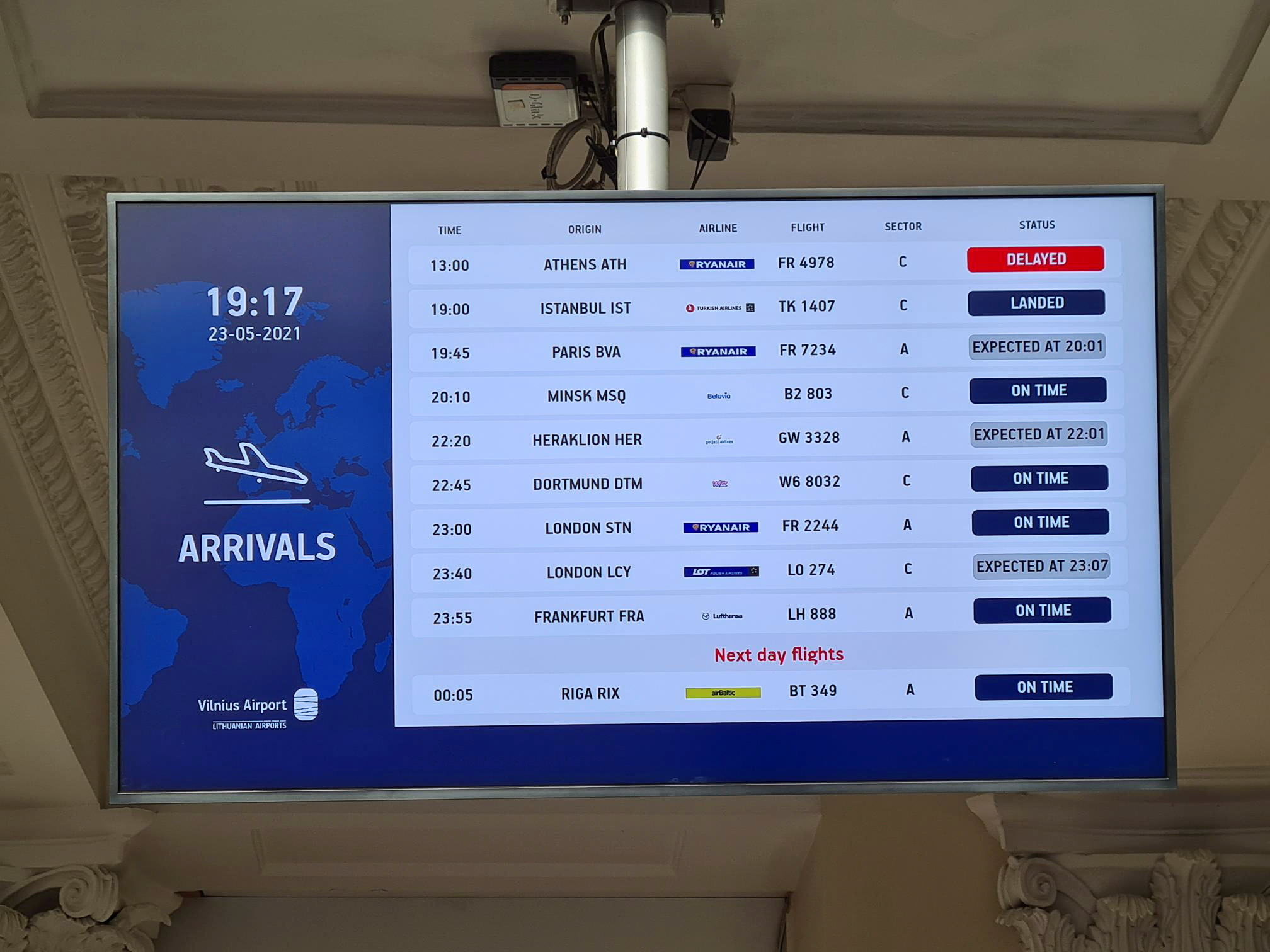 An information board showing international arrivals is pictured at Vilnius Airport, in Vilnius, Lithuania May 23, 2021. REUTERS/Andrius Sytas